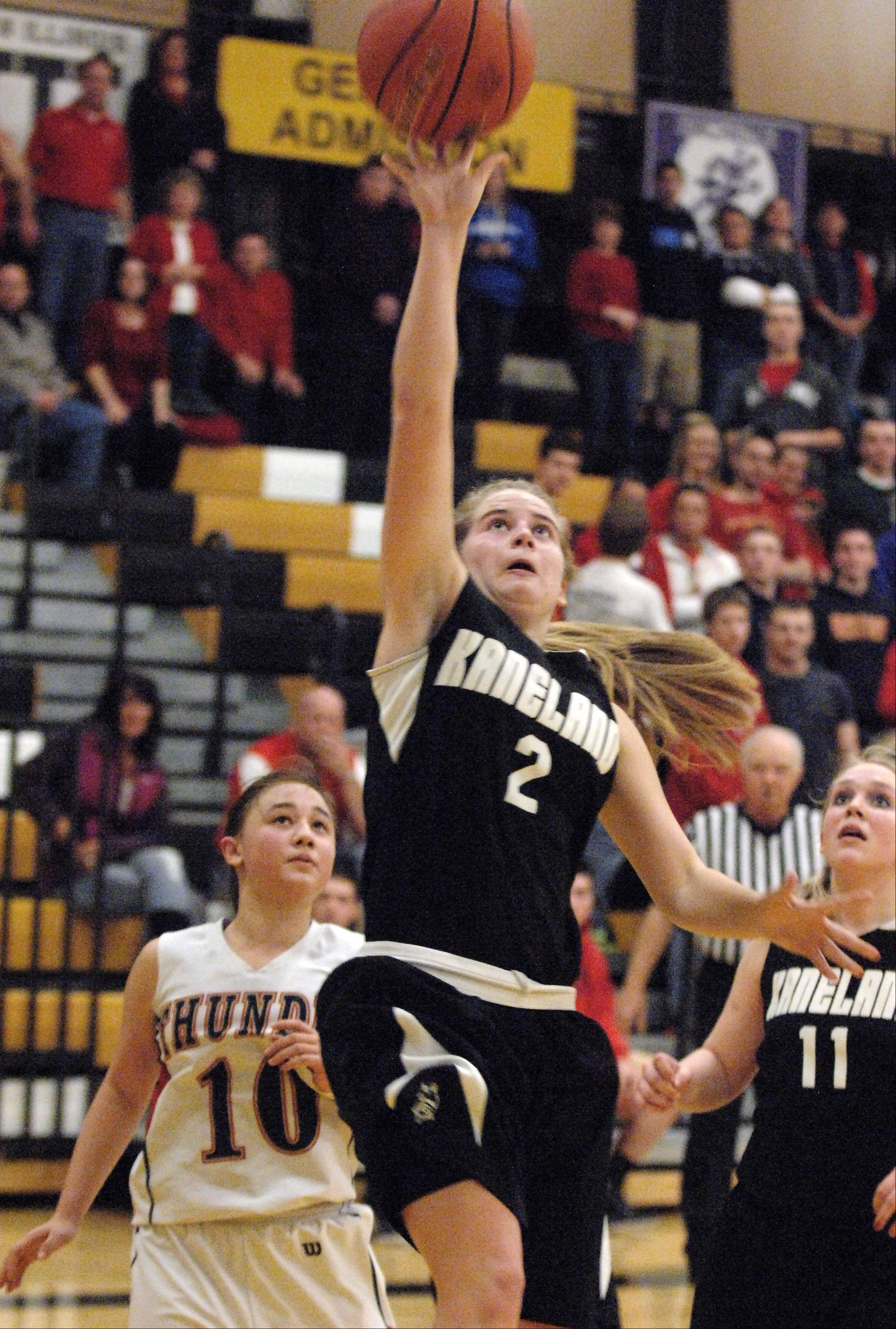 Kaneland's Sarah Grams drives and scores to close the gap in the final minutes.