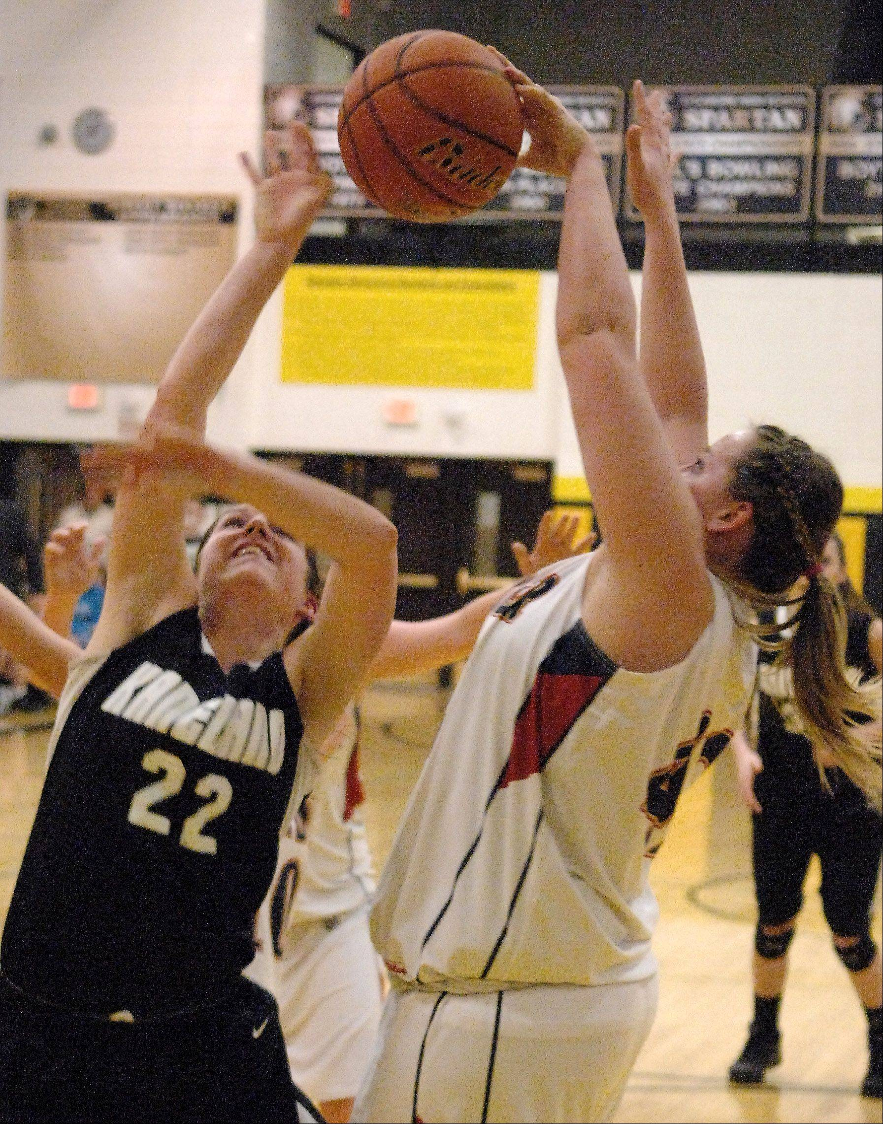 Kaneland's Brooke Harner has her shot blocked by Belvidere North's Katie Dovenmuehle during Thursday's sectional championship in Sycamore.