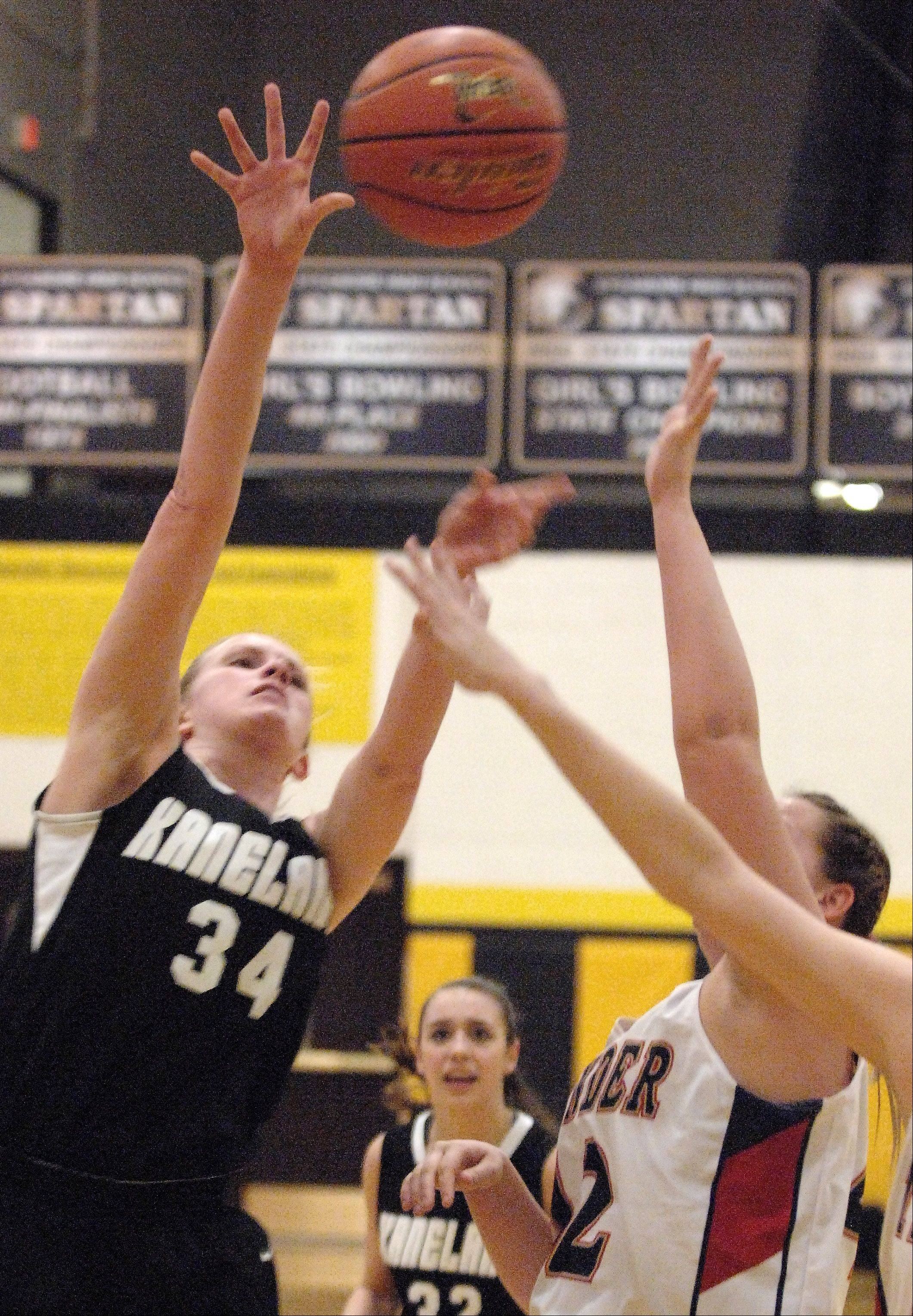 Kaneland's Kelly Evers shoots against Belvidere North.