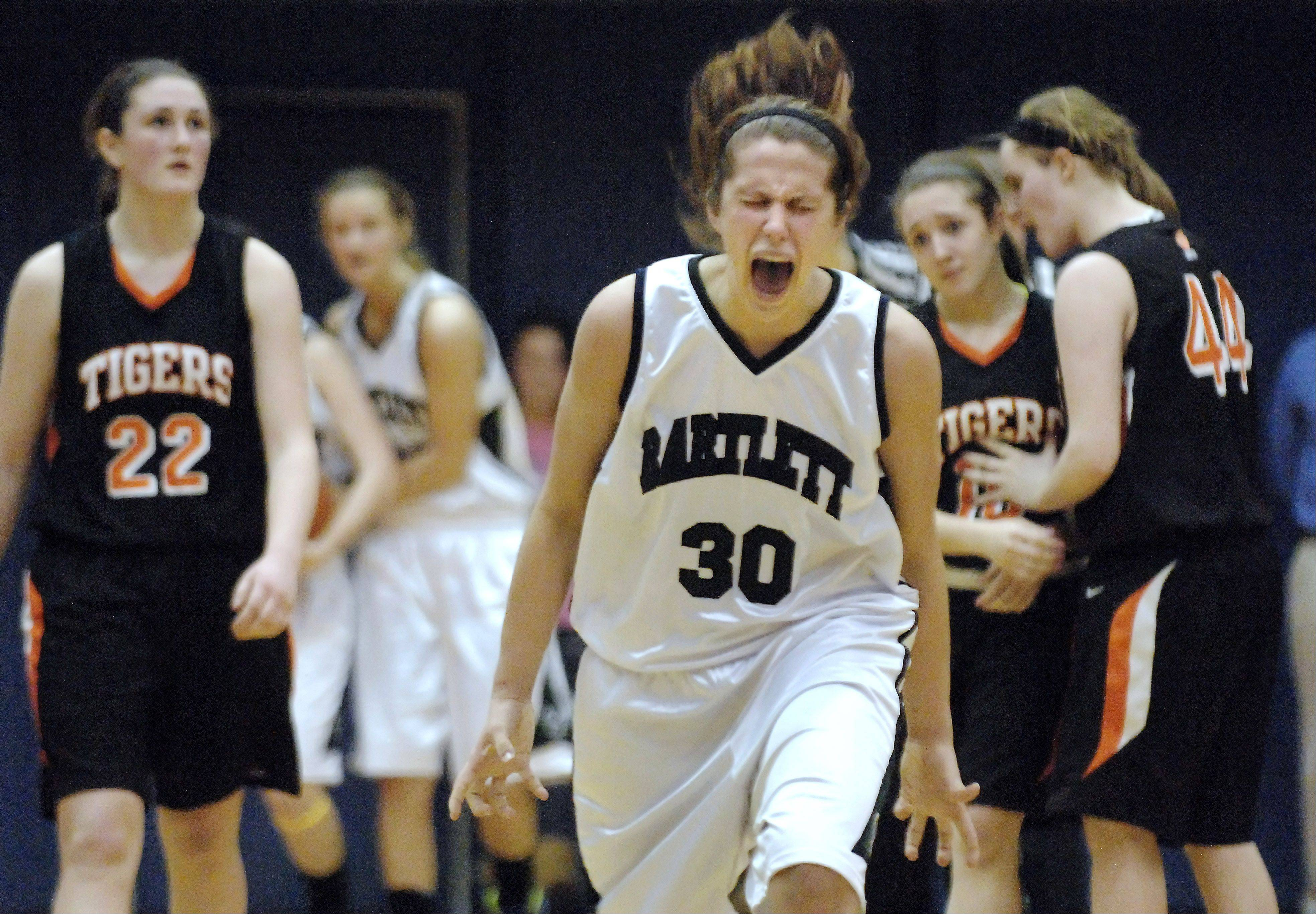 Bartlett's Lisa Palmer yells in victory as a foul is called on Wheaton Warrenville South with seconds left in overtime and Bartlett ahead.