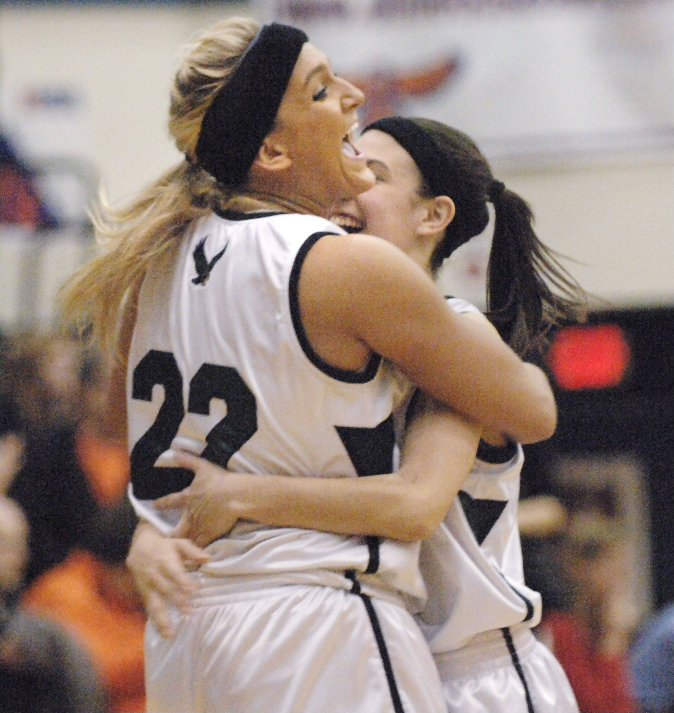 Bartlett's Haley Videckis and Janessa Baker, right, hug after beating Wheaton Warrenville South.