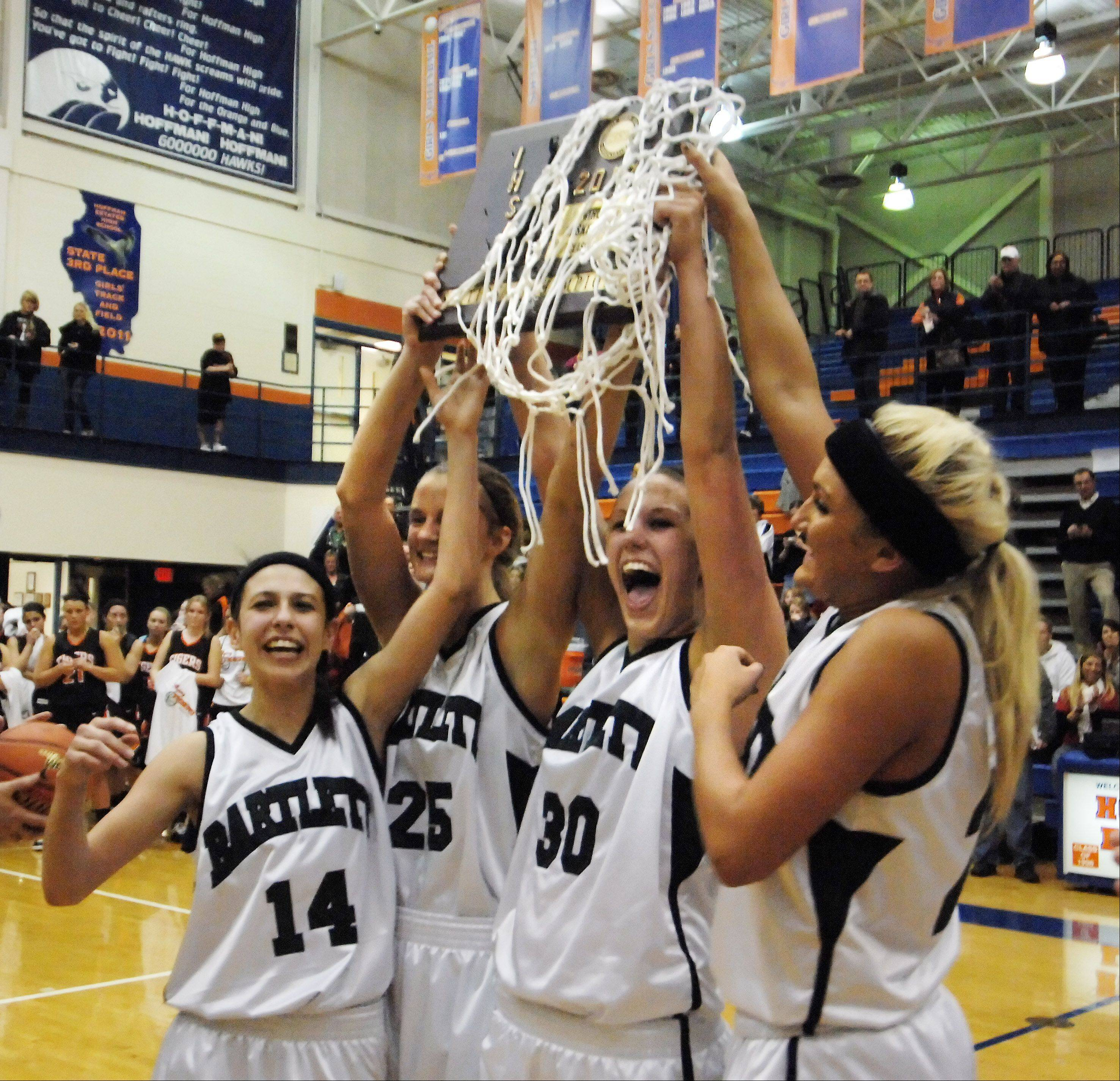 Bartlett's Janessa Baker, left, Kristin Conniff, Lisa Palmer and Haley Videckis, right, hold the sectional trophy .