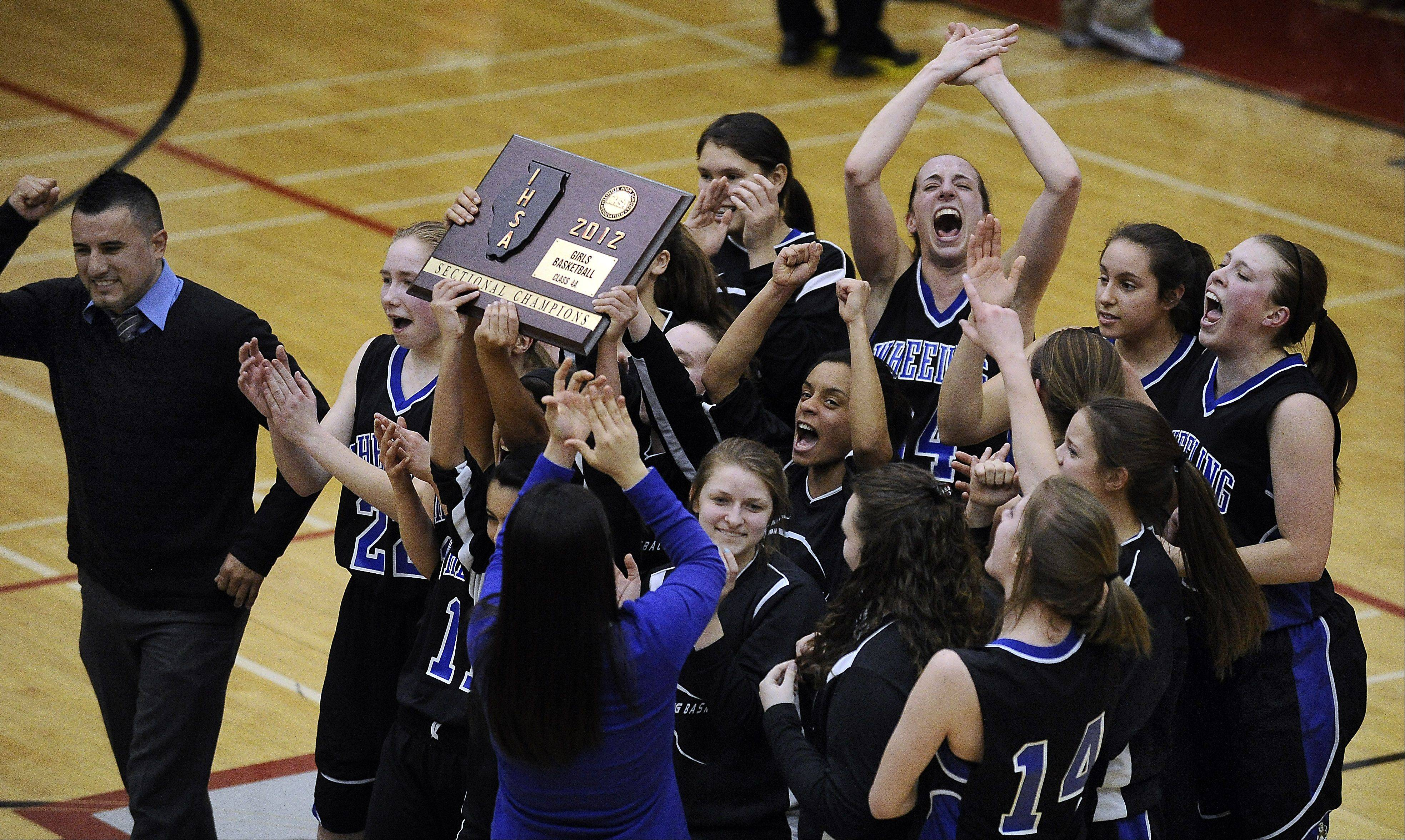 Wheeling celebrates its girls basketball Class 4A sectional championship Thursday at Palatine. The Wildcats play in Monday's 7:30 p.m. Stevenson supersectional against Loyola.
