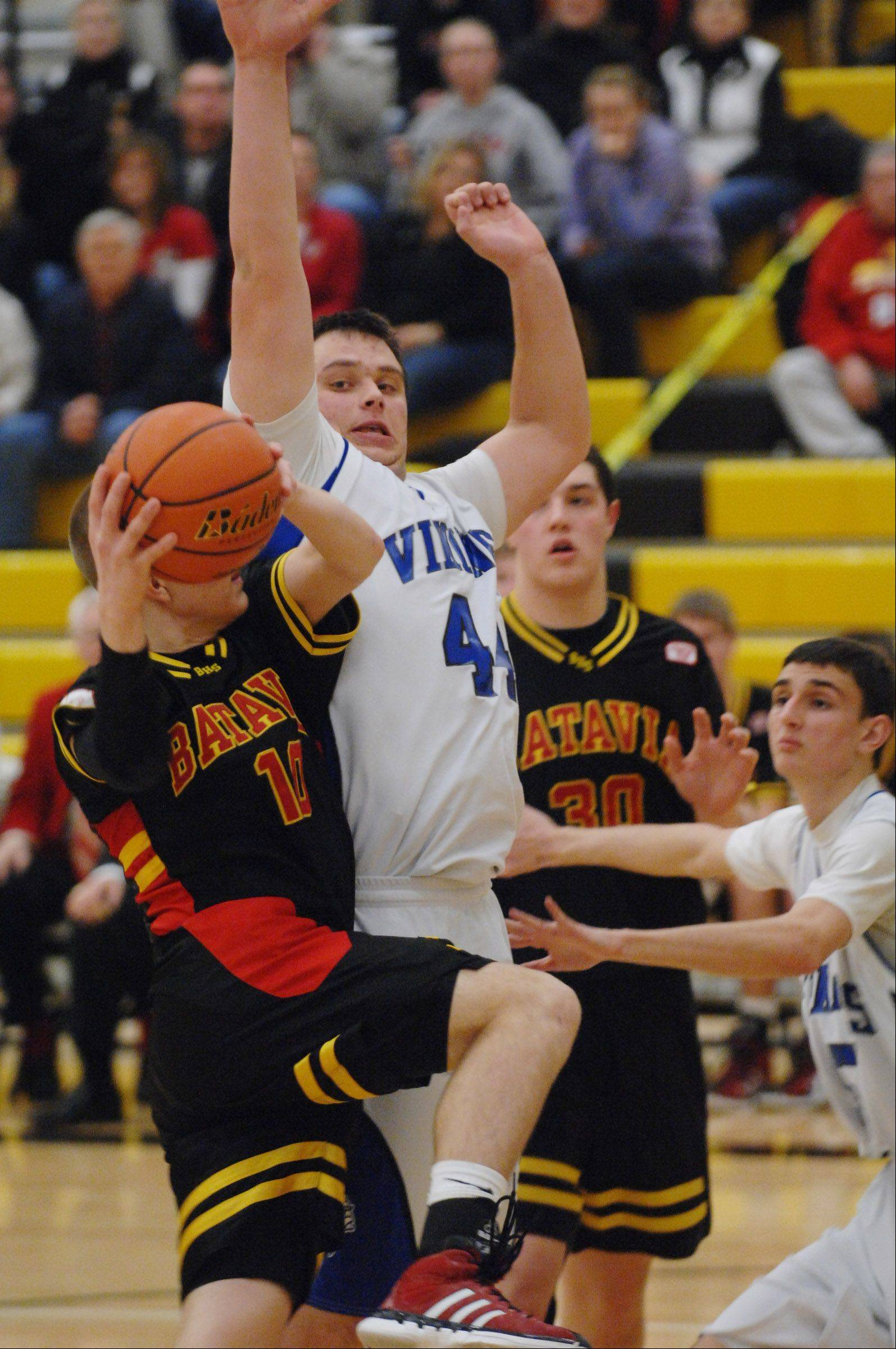 Geneva's Connor Chapman defends and fouls Batavia's Mike Rueffer at the Metea Valley regional game Monday.