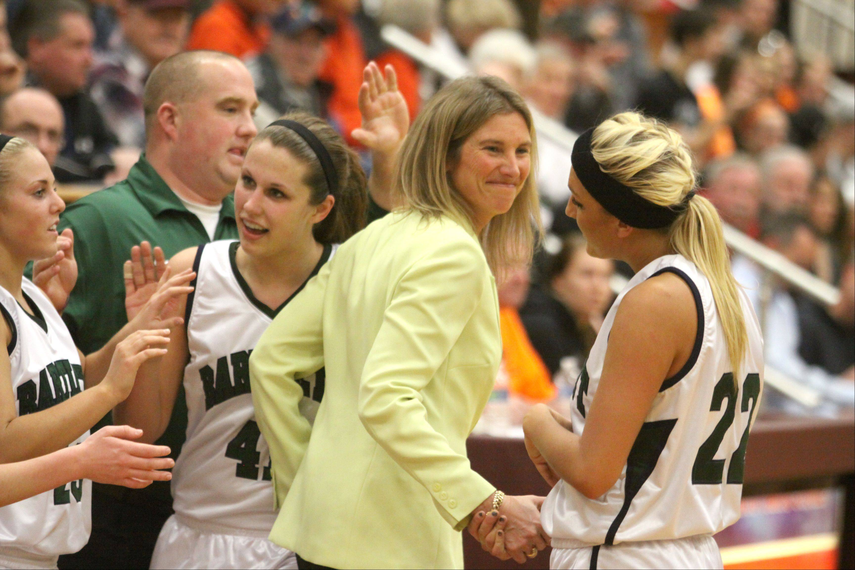 Bartlett head coach Denise Sarna, center, offers congratulations to her starters as they exit the game late in a supersectional win over DeKalb at Chesbrough Field House in Elgin on Monday night. At right is Haley Videckis, and at left is Lisa Palmer.