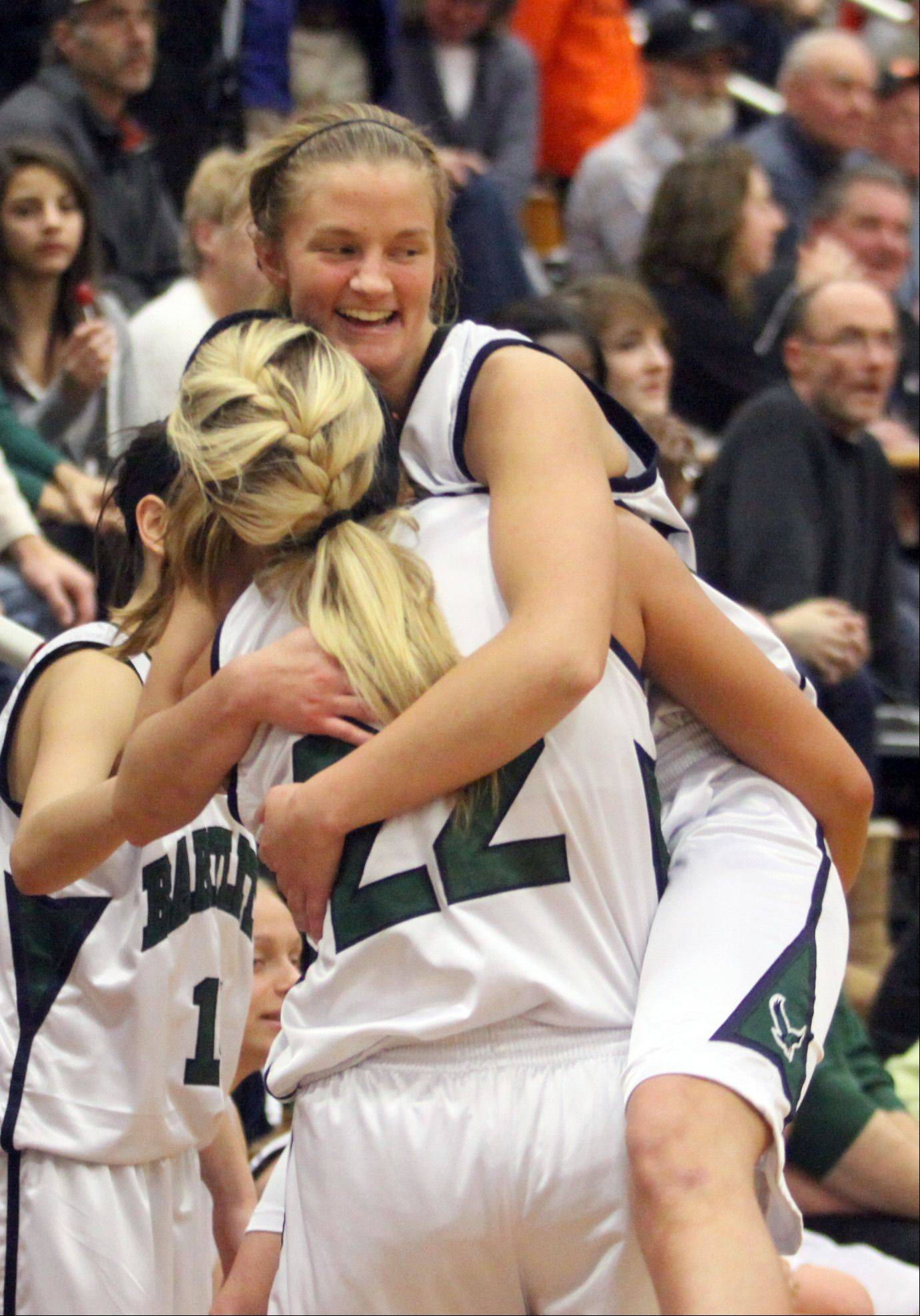 Bartlett's Kristin Conniff gets a lift from teammate Haley Videckis as they celebrate a supersectional victory over DeKalb at Chesbrough Field House in Elgin on Monday night.