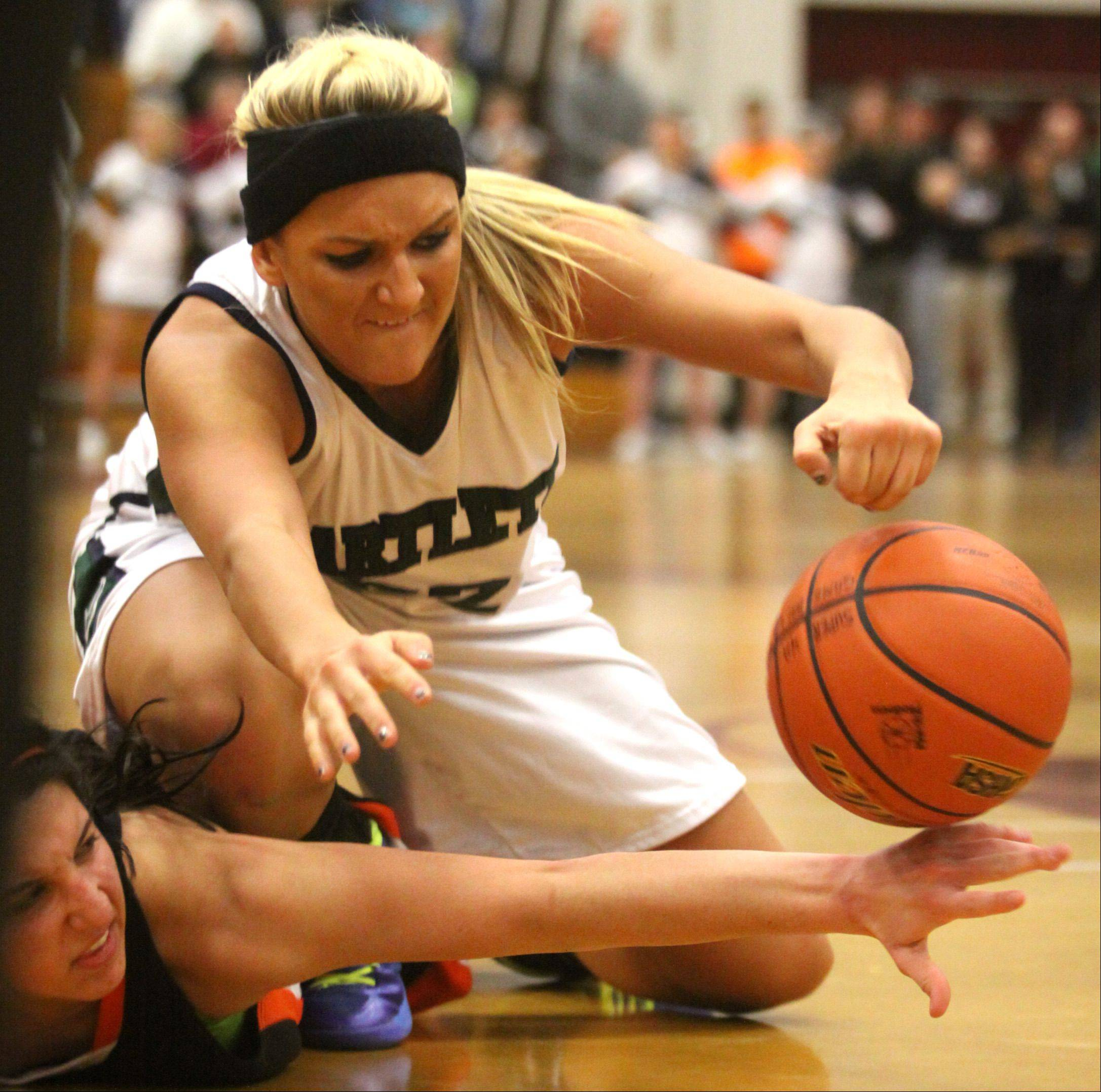 Haley Videckis of Bartlett lunges for the basketball during a supersectional against DeKalb at Chesbrough Field House in Elgin on Monday night.