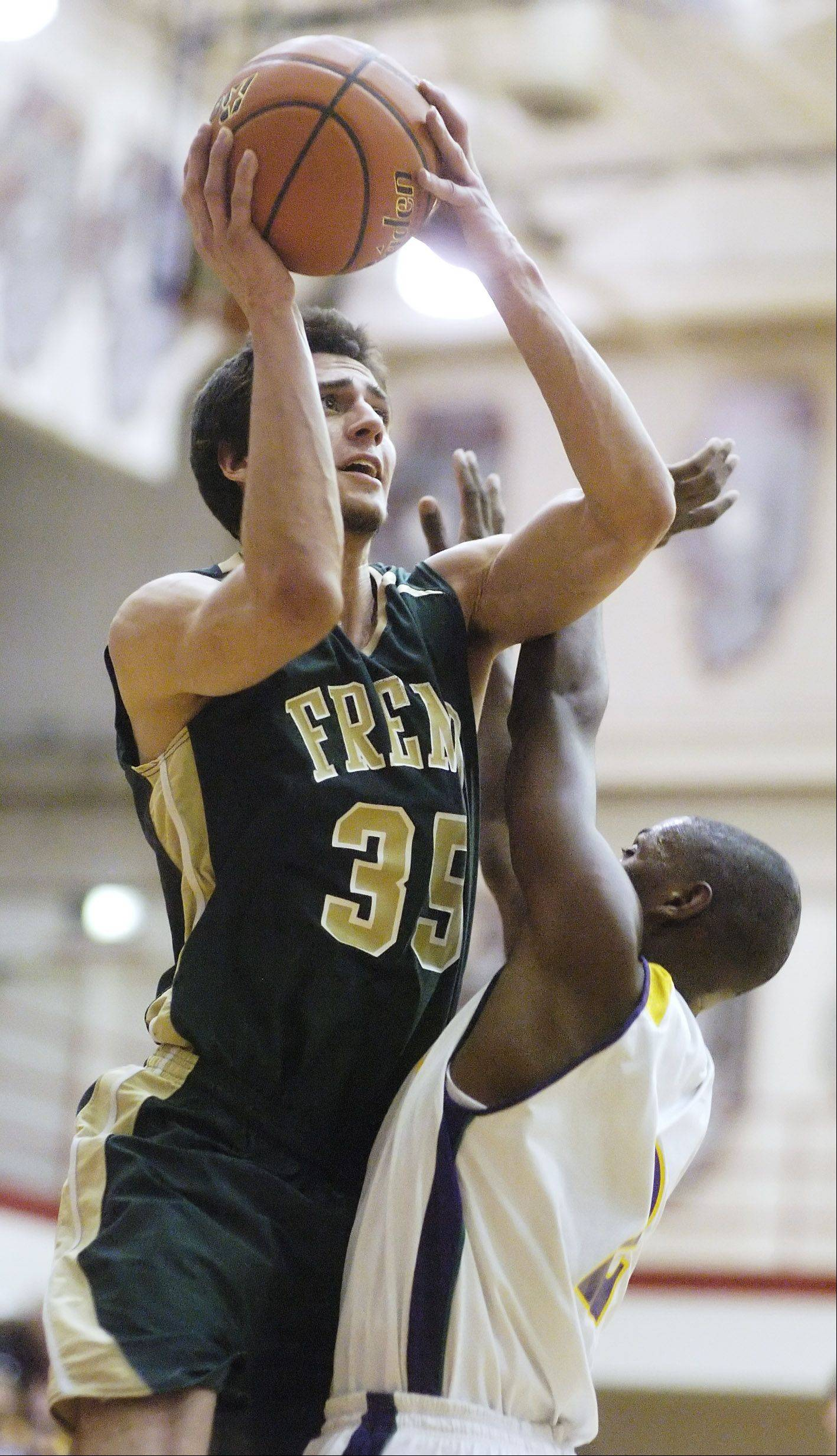Fremd's Adam Gorecki makes a strong move to the basket against Waukegan's Akeem Springs during Tuesday's regional semifinal at Palatine.