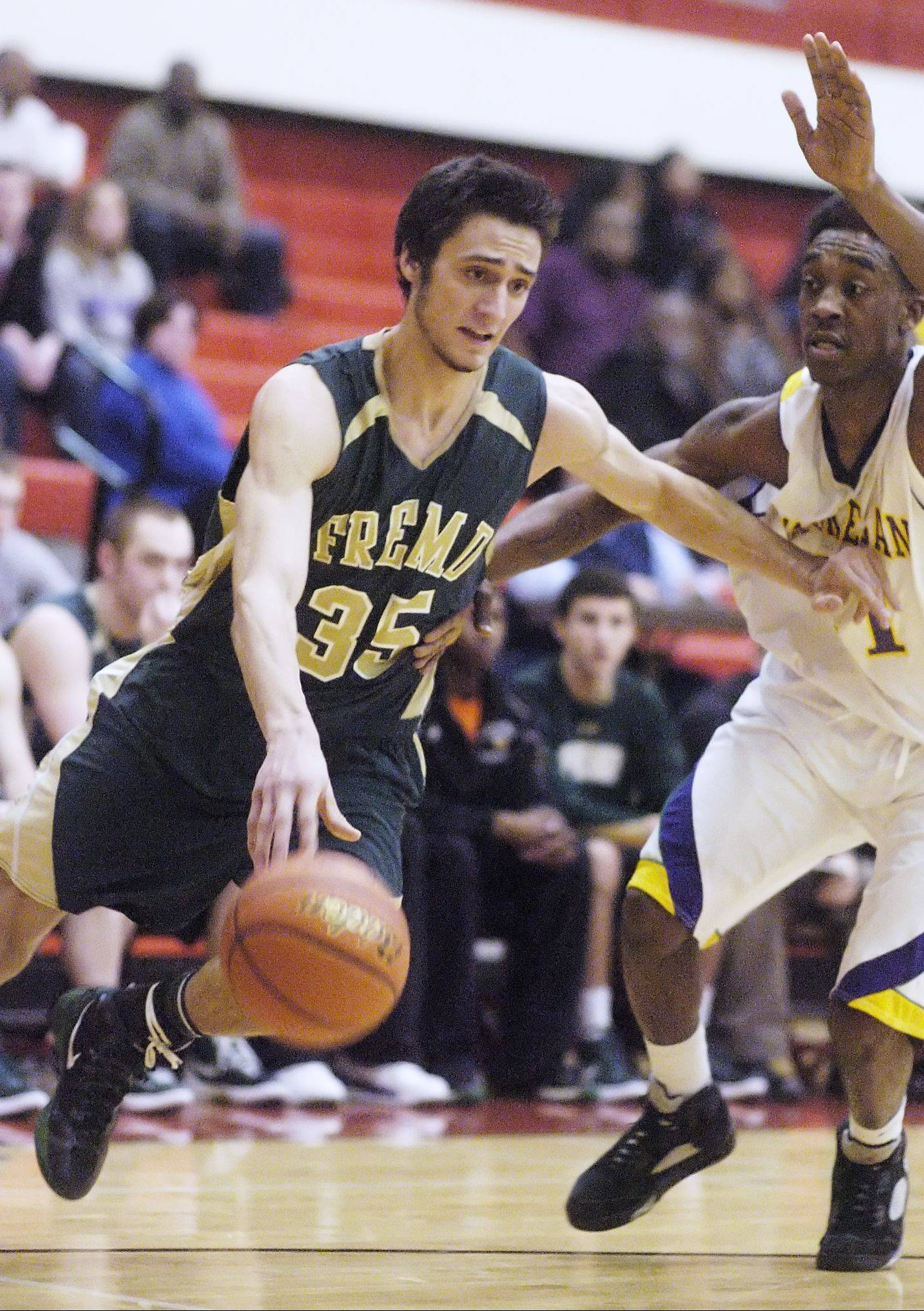 Fremd's Adam Gorecki, left, drives on Waukegan defender DeVonte Taylor during Tuesday's regional semifinal at Palatine. The No. 13 seed Vikings handled the No. 4 Bulldogs 71-54 to earn a spot in Friday's regional championship.