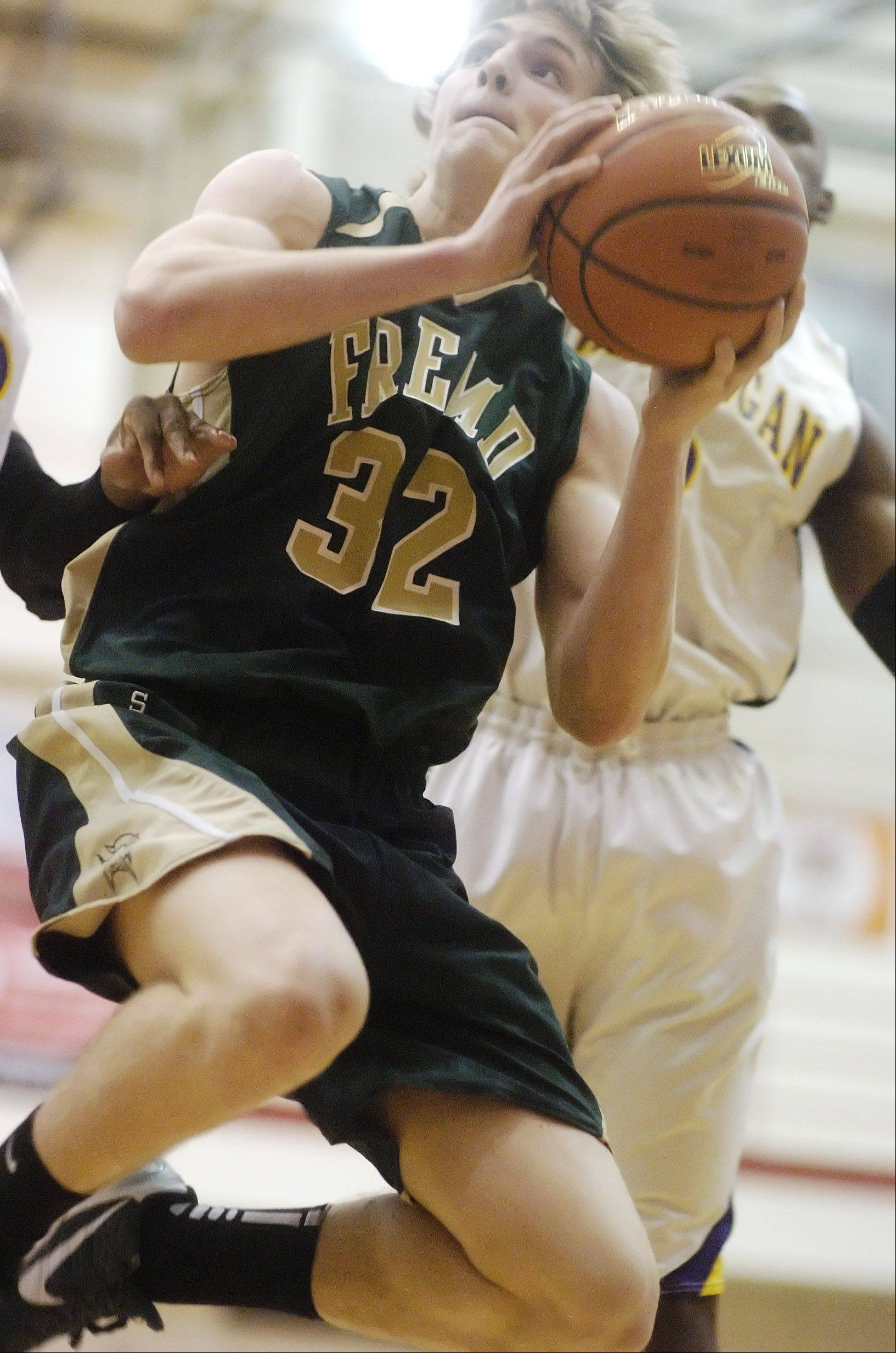 Fremd's Nate Serviss takes the ball to the hoop during Tuesday's regional semifinal at Palatine.
