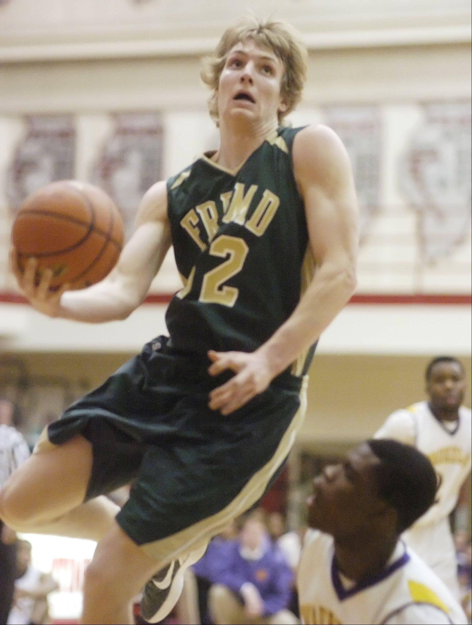 Fremd's Nate Serviss drives to the basket for a layup.