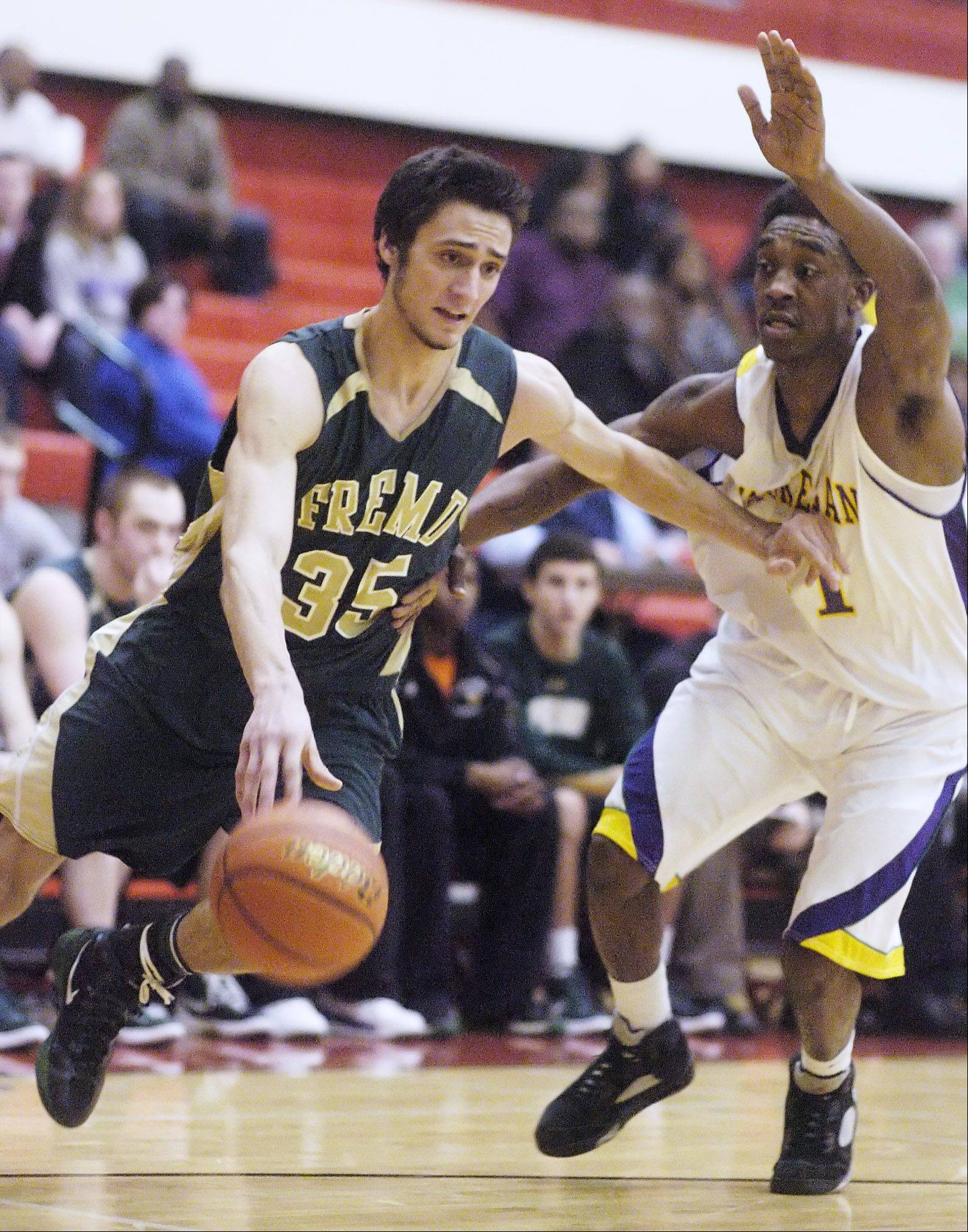 Fremd's Adam Gorecki, left, drives on Waukegan defender DeVonte Taylor.