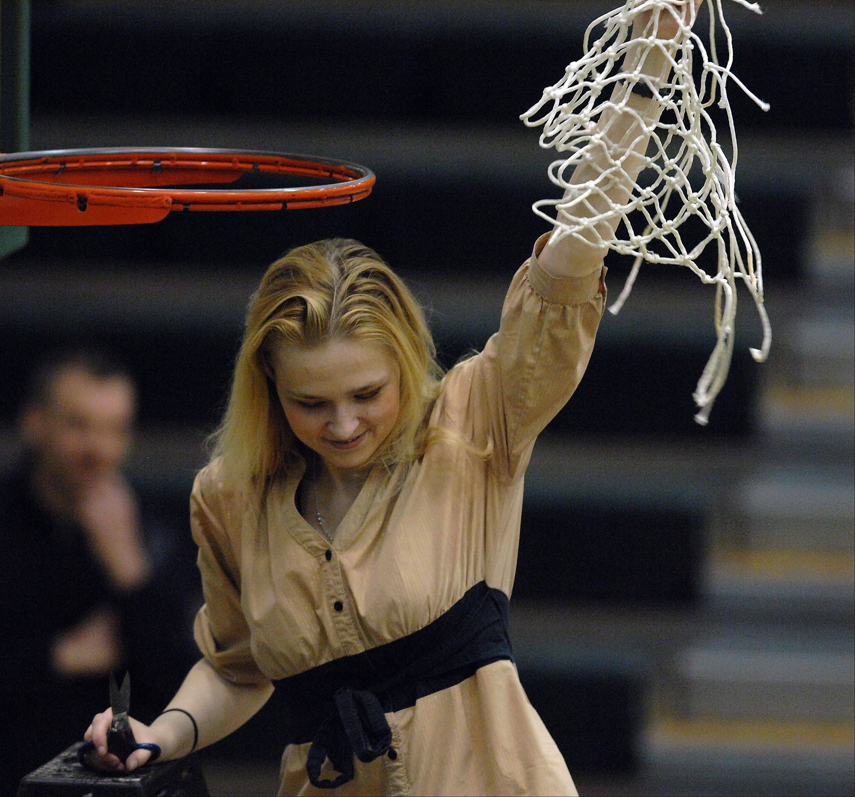 Kathie Swanson is cutting ties with Libertyville after coaching the girls basketball team to three straight NSC titles and averaging more than 20 wins over six seasons.