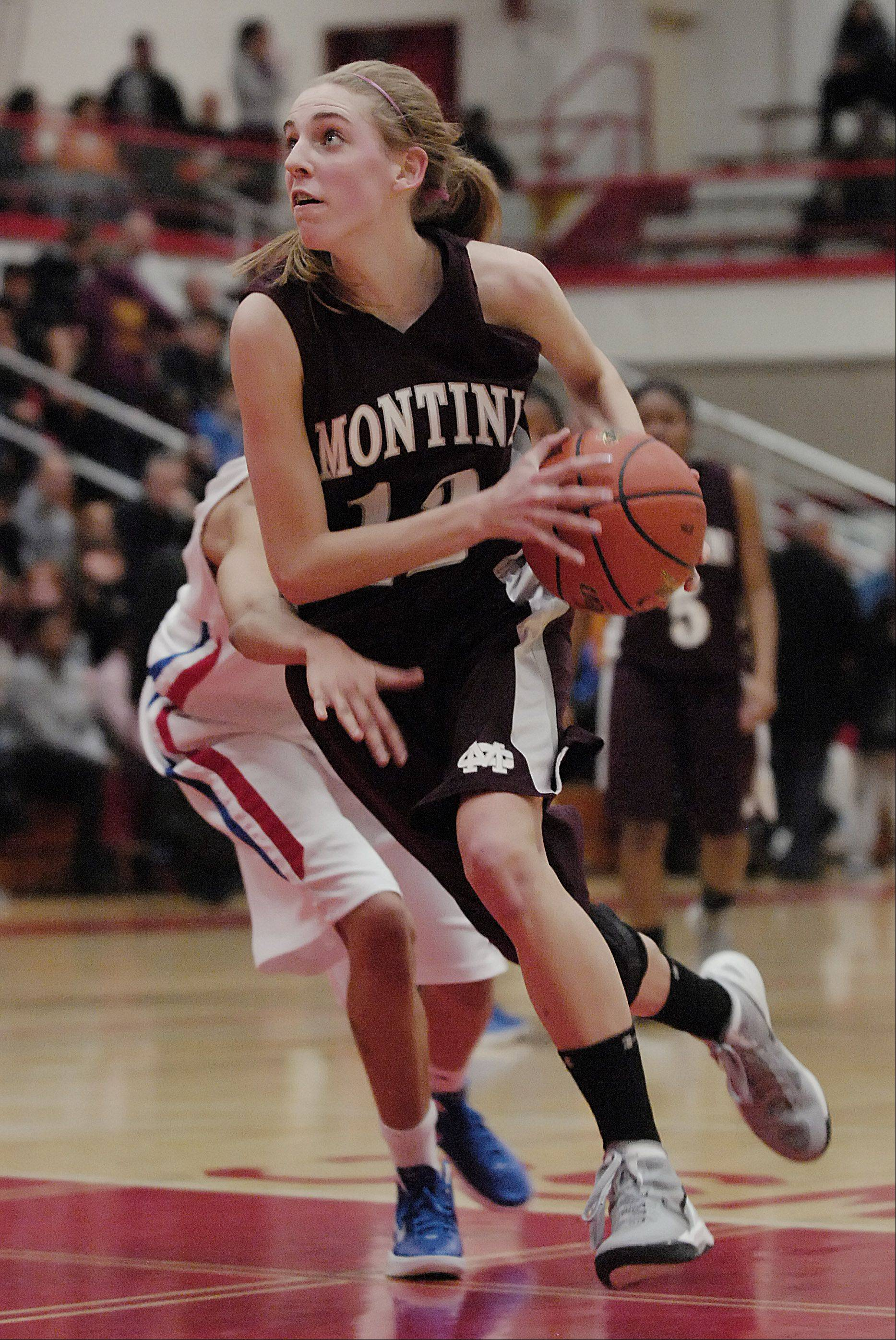 Kelly Karlis of Montini drives to the hoop during their victory over Crane in the girls Class 3A supersectional basketball game Monday, February 27, 2012 at Hinsdale Central.