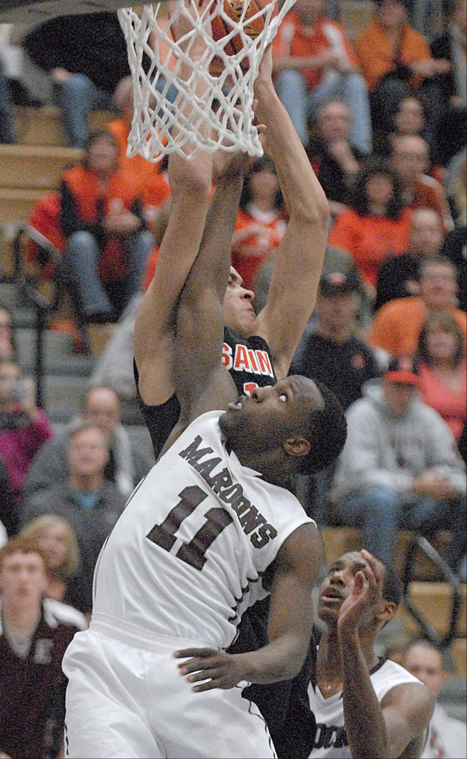 St. Charles East's Kendall Stephens and Elgin's Dennis Moore fight for a rebound in the fourth quarter.