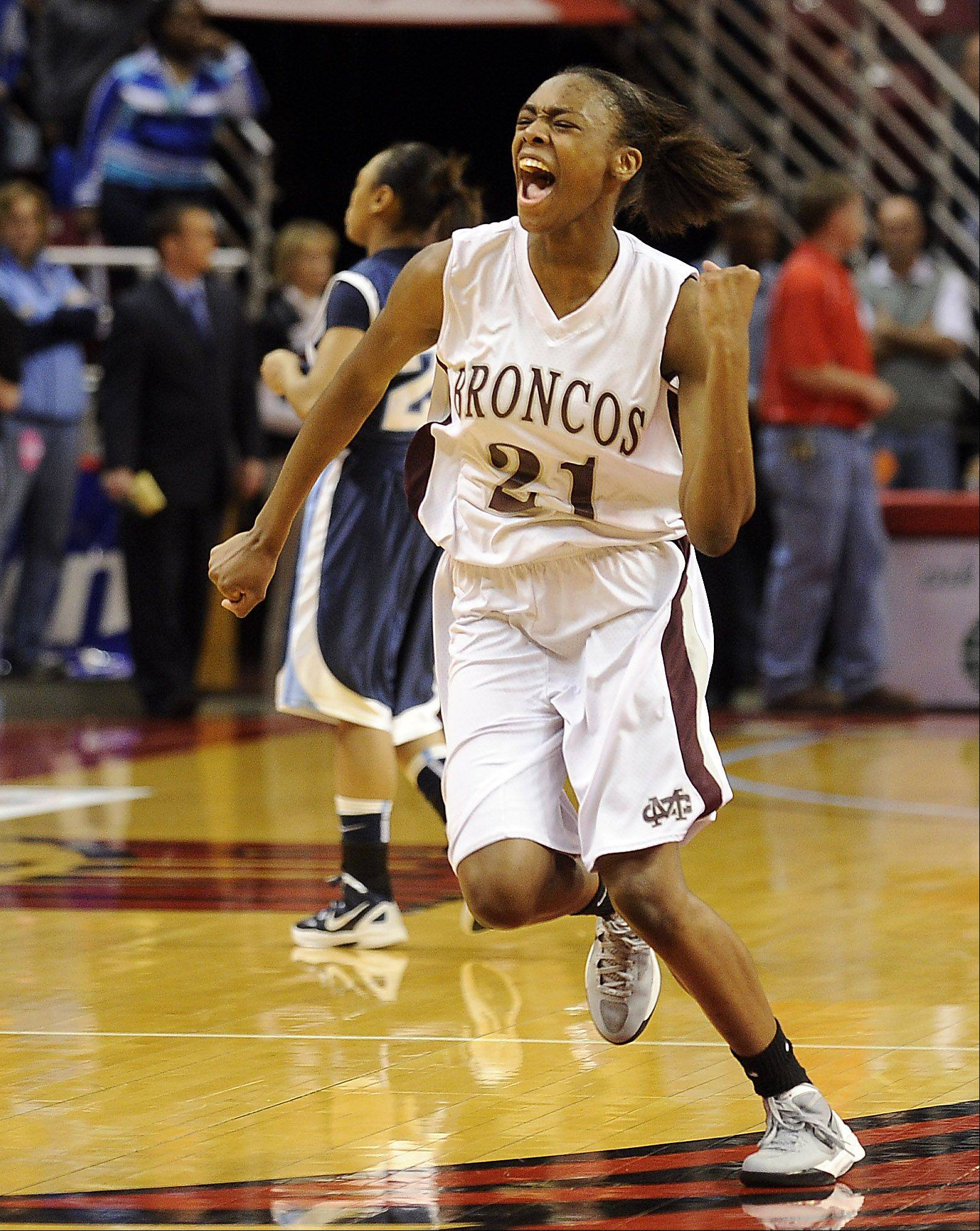 Montini's Jasmine Lumpkin celebrates their victory over Hillcrest in the 2012 IHSA Class 3A Girls Basketball Tournament in Normal, Illinois on Friday.