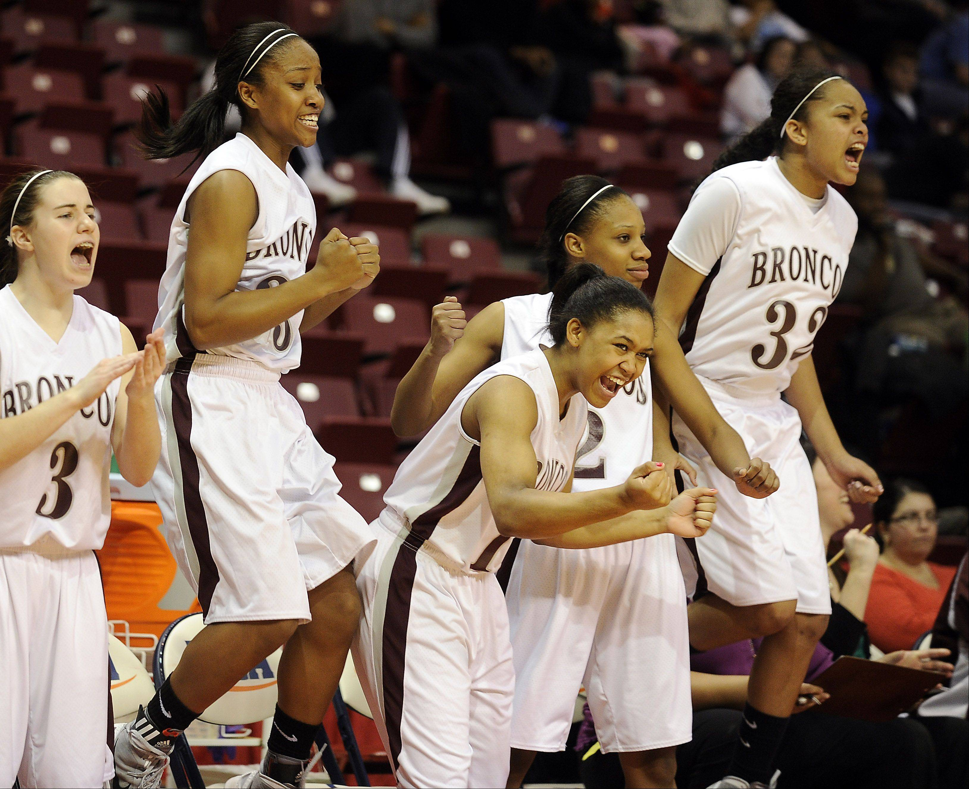 Montini's bench celebrates their victory over Hillcrest in the 2012 IHS	A Class 3A Girls Basketball Tournament in Normal, Illinois on Friday.