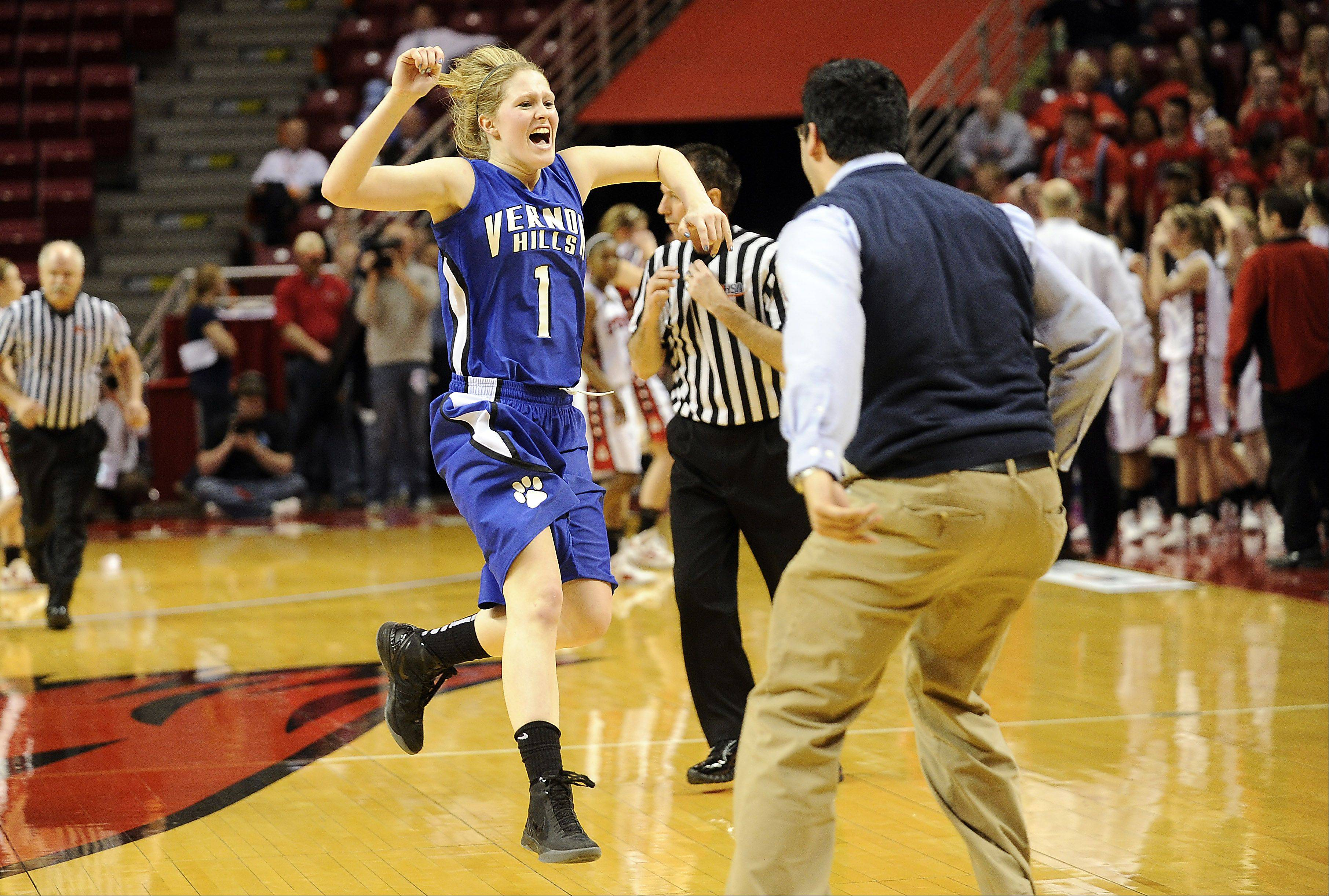 Vernon Hills' Sydney Smith jumps for joy during the Cougars' victory over Springfield in the Class 3A state semifinals in Normal Friday.