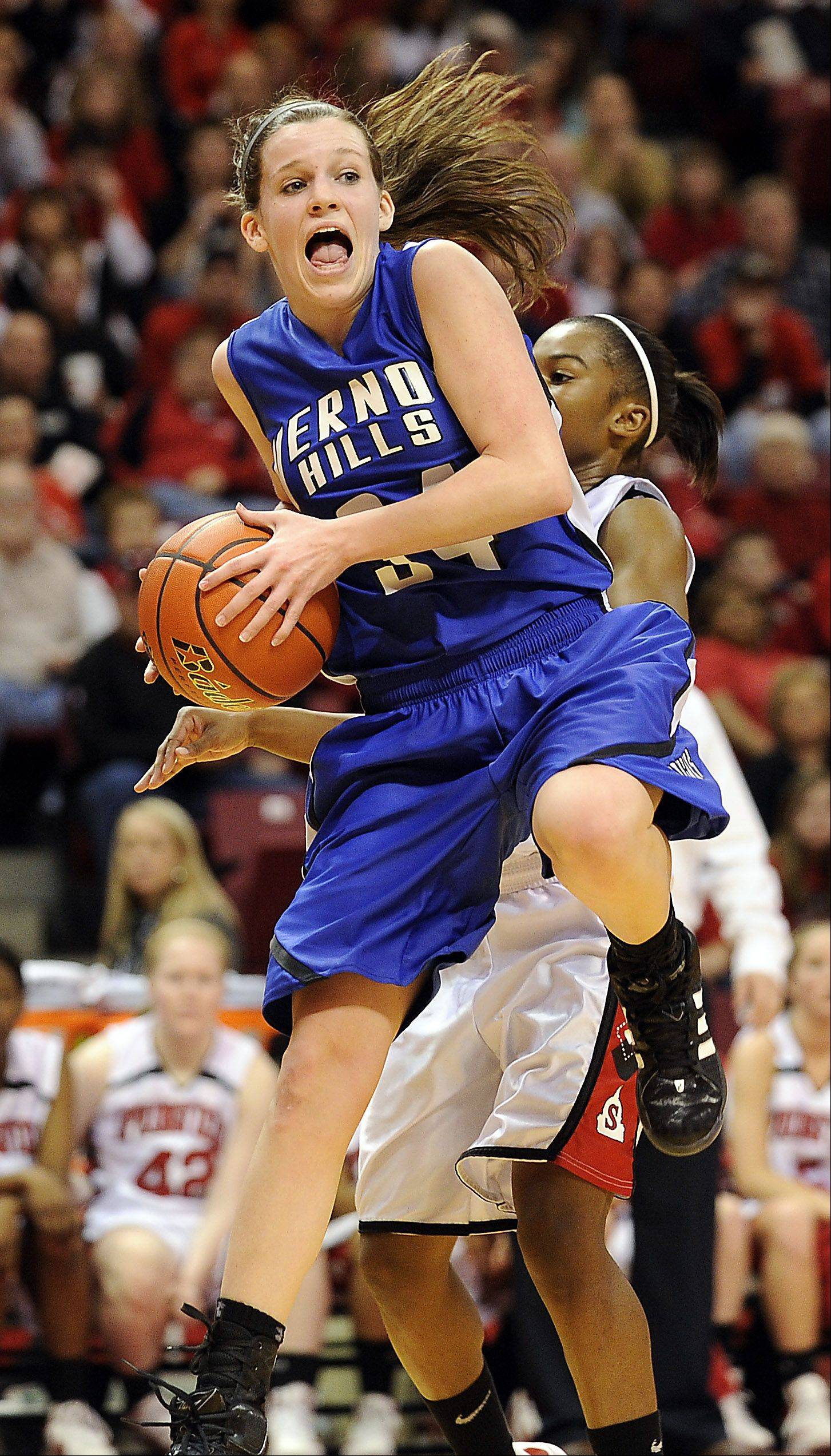 Mark Welsh/mwelsh@dailyherald.comVernon Hills' Abby Springer pulls down a rebound in the second quarter in the 2012 IHSA Class 3A girls basketball tournament in Normal, Illinois on Friday.