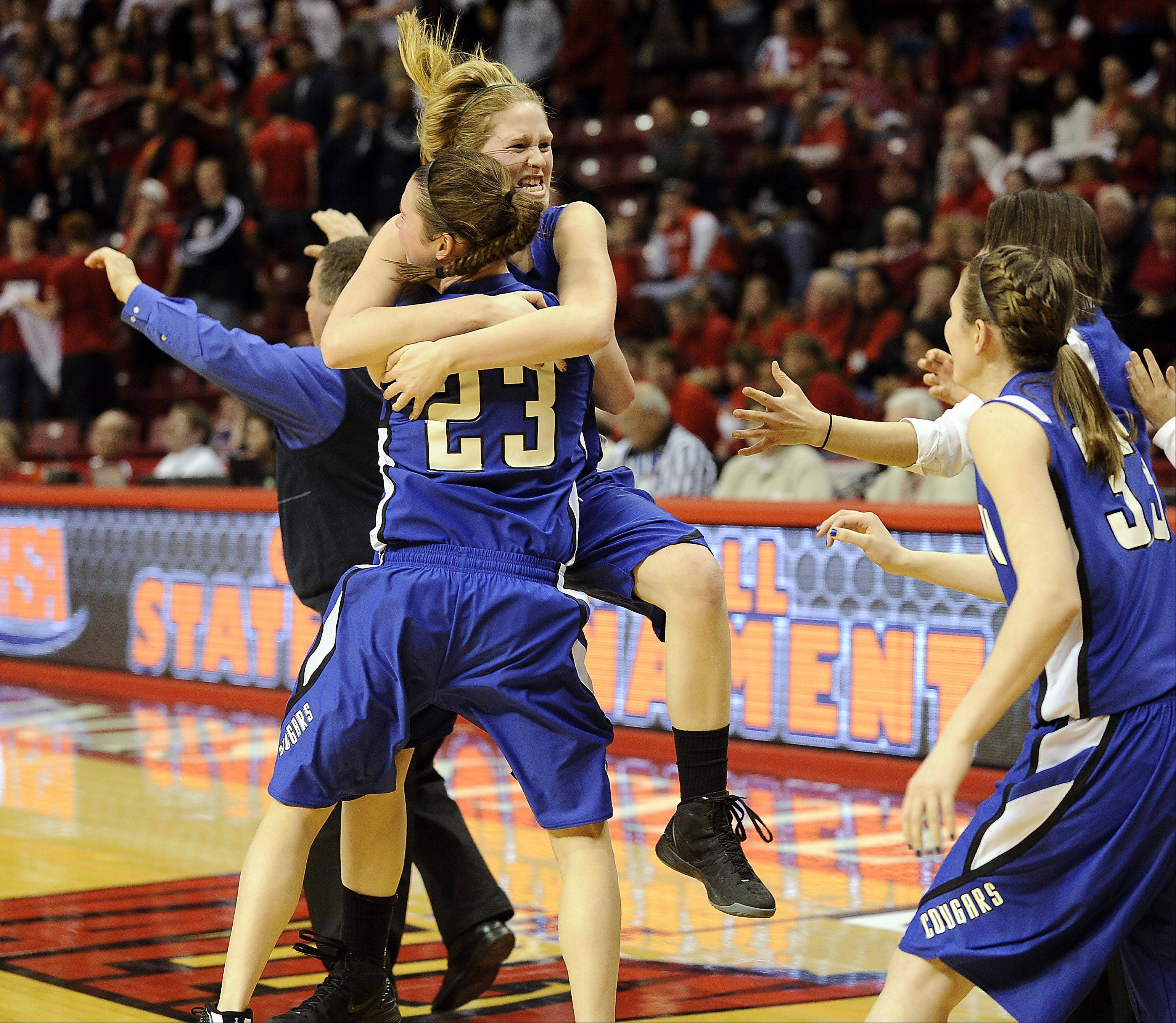 Vernon Hills' Sydney Smith jumps into the arms of teammate Brie Bahlmann in their victory over Springfield in the fourth quarter of play in the 2012 IHSA Class 3A girls basketball tournament in Normal, Illinois on Friday.