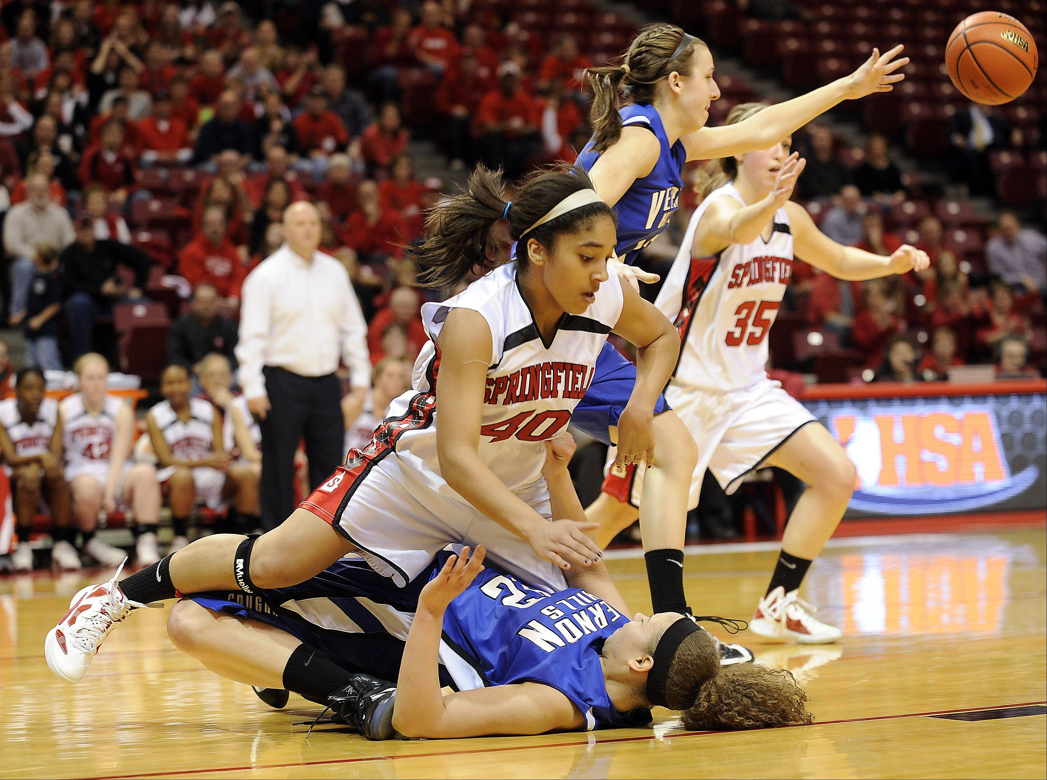 Vernon Hills' Lauren Webb hits the floor hard with the help of Springfield's Anika Webster in the second quarter of play in the 2012 IHSA Class 3A girls basketball tournament in Normal, Illinois on Friday.