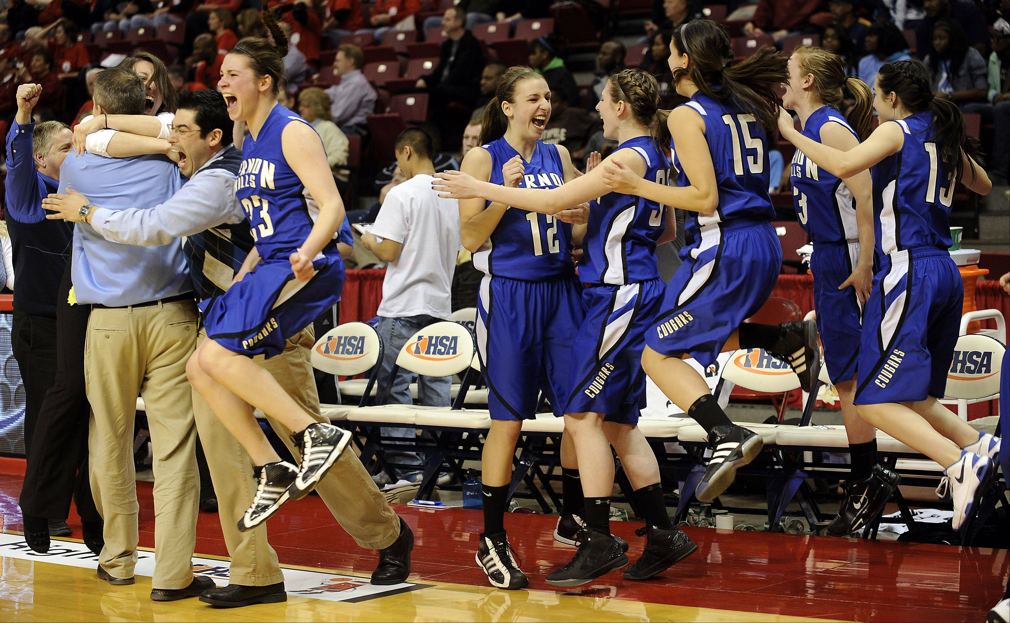 Vernon Hills' Brie Bahlmann leads the bench in their victory over Springfield in the fourth quarter of play in the 2012 IHSA Class 3A girls basketball tournament in Normal, Illinois on Friday.