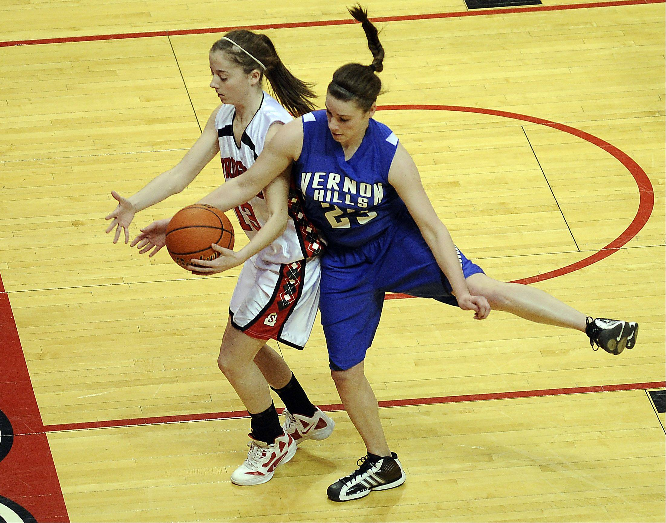 Vernon Hills' Brie Bahlmann fouls Springfield's Julia Rosen as they battle for control in the first quarter of play in the girls 2012 IHSA Class 3A in Normal, Illinois on Friday.