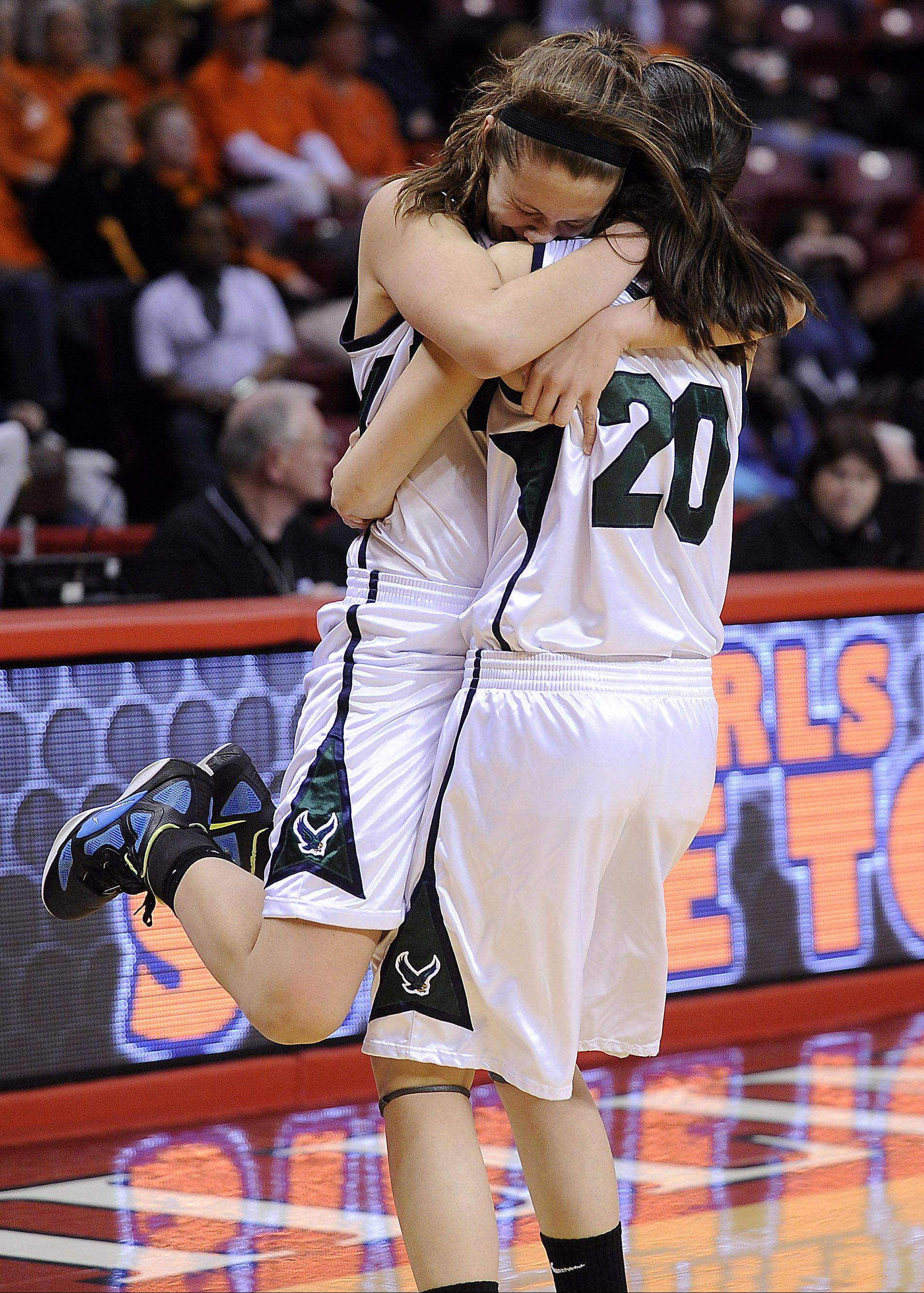 Mark Welsh/mwelsh@dailyherald.comBartlett's Lisa Palmer and teammate Elizabeth Arco celebrate their OT win against Loyola Academy in the Class 4A third-place game Saturday at Redbird Arena in Normal.