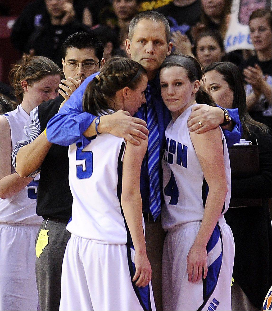 Vernon Hills' coach Paul Brettner hugs his players Julie Pecht and Abby Springer after their loss to Montini in the 2012 IHSA Class 3A Girls basketball Tournament in Normal, Illinois on Saturday.