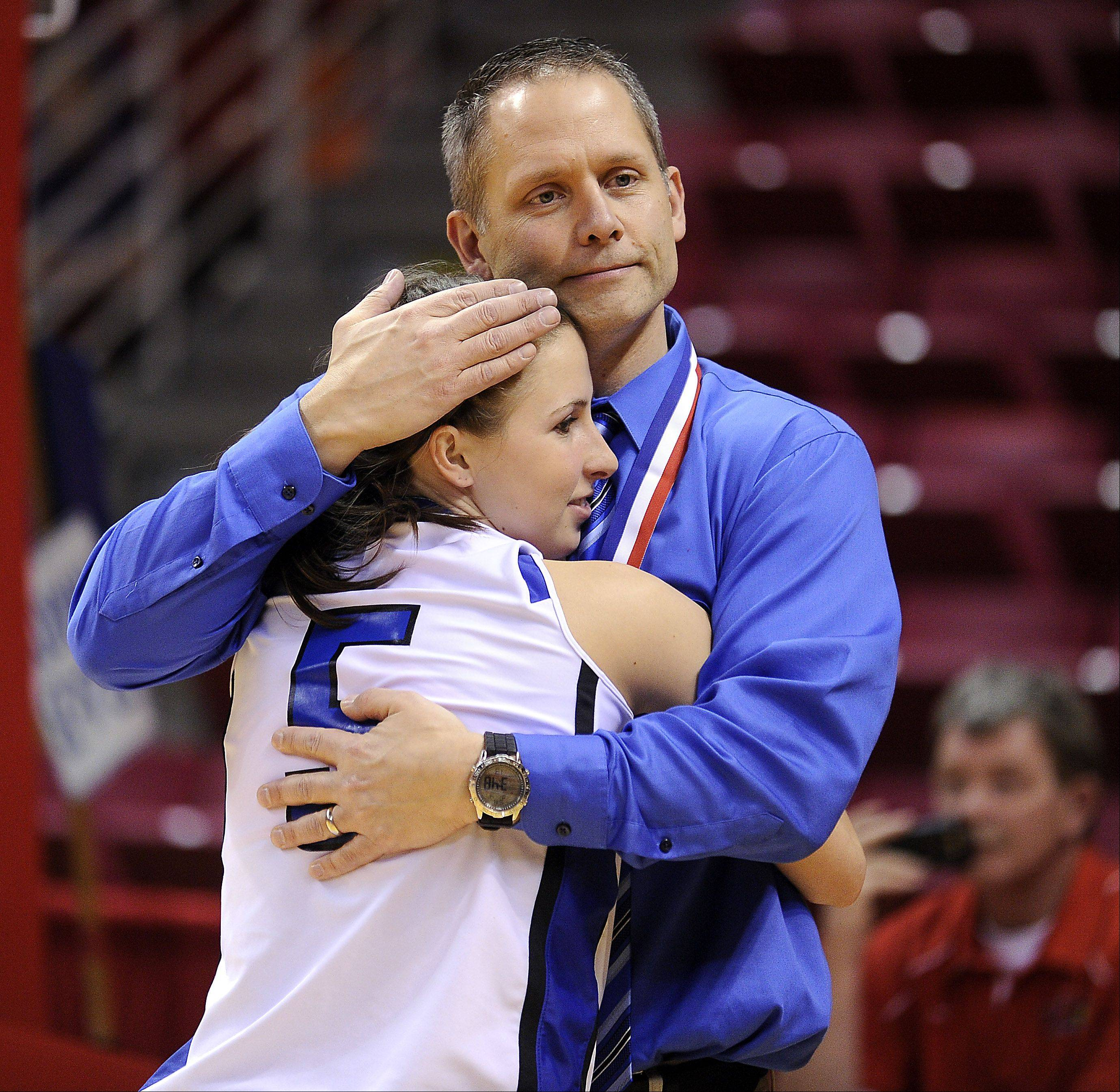 Vernon Hills' coach Paul Brettner hugs his player Julie Pecht after their loss to Montini in the 2012 IHSA Class 3A Girls basketball Tournament in Normal, Illinois on Saturday.