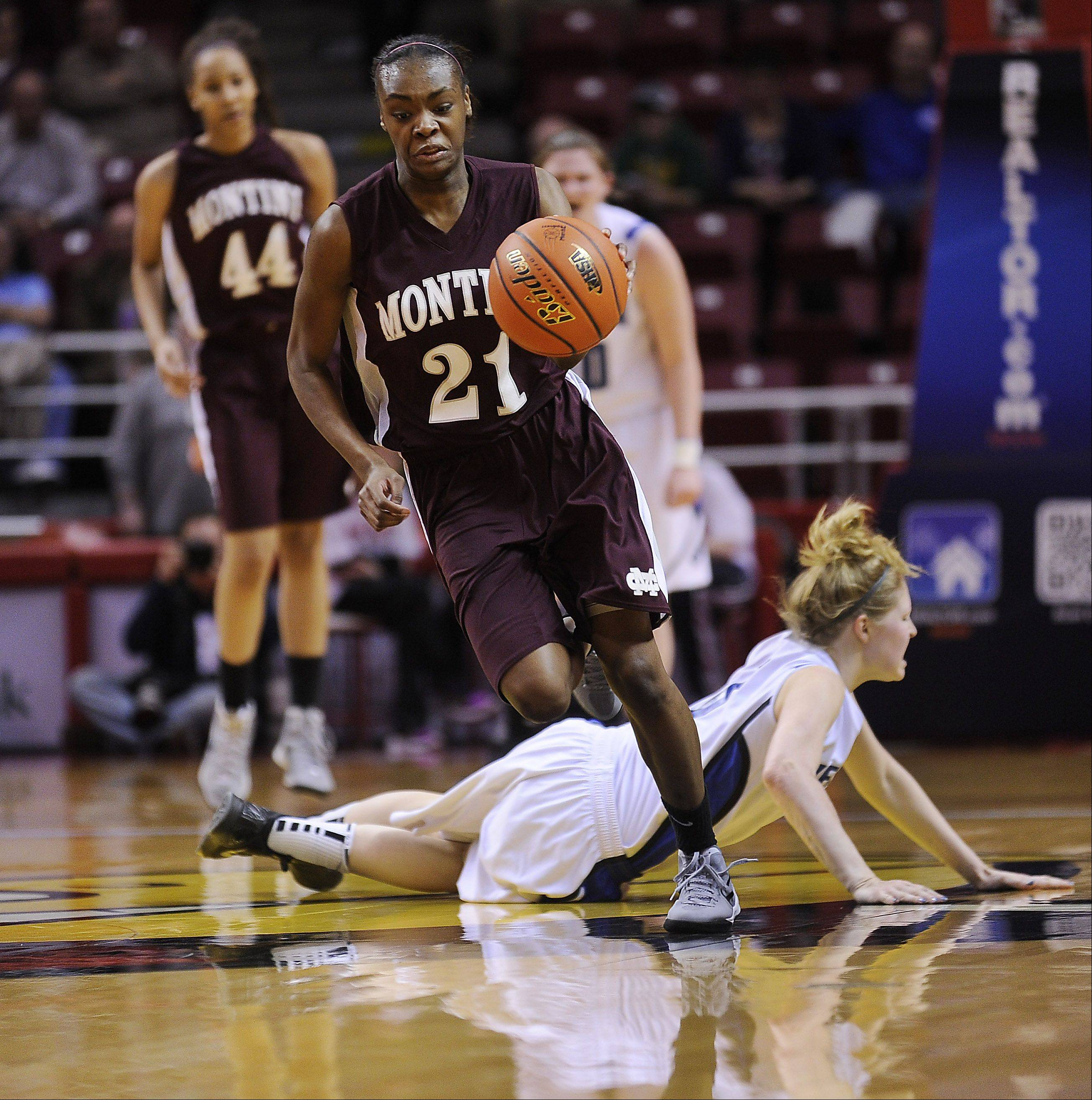 Montini's Jasmine Lumpkin plows over Vernon Hills' Sydney Smith in the first half of the 2012 IHSA Class 3A Girls basketball Tournament in Normal, Illinois on Saturday.