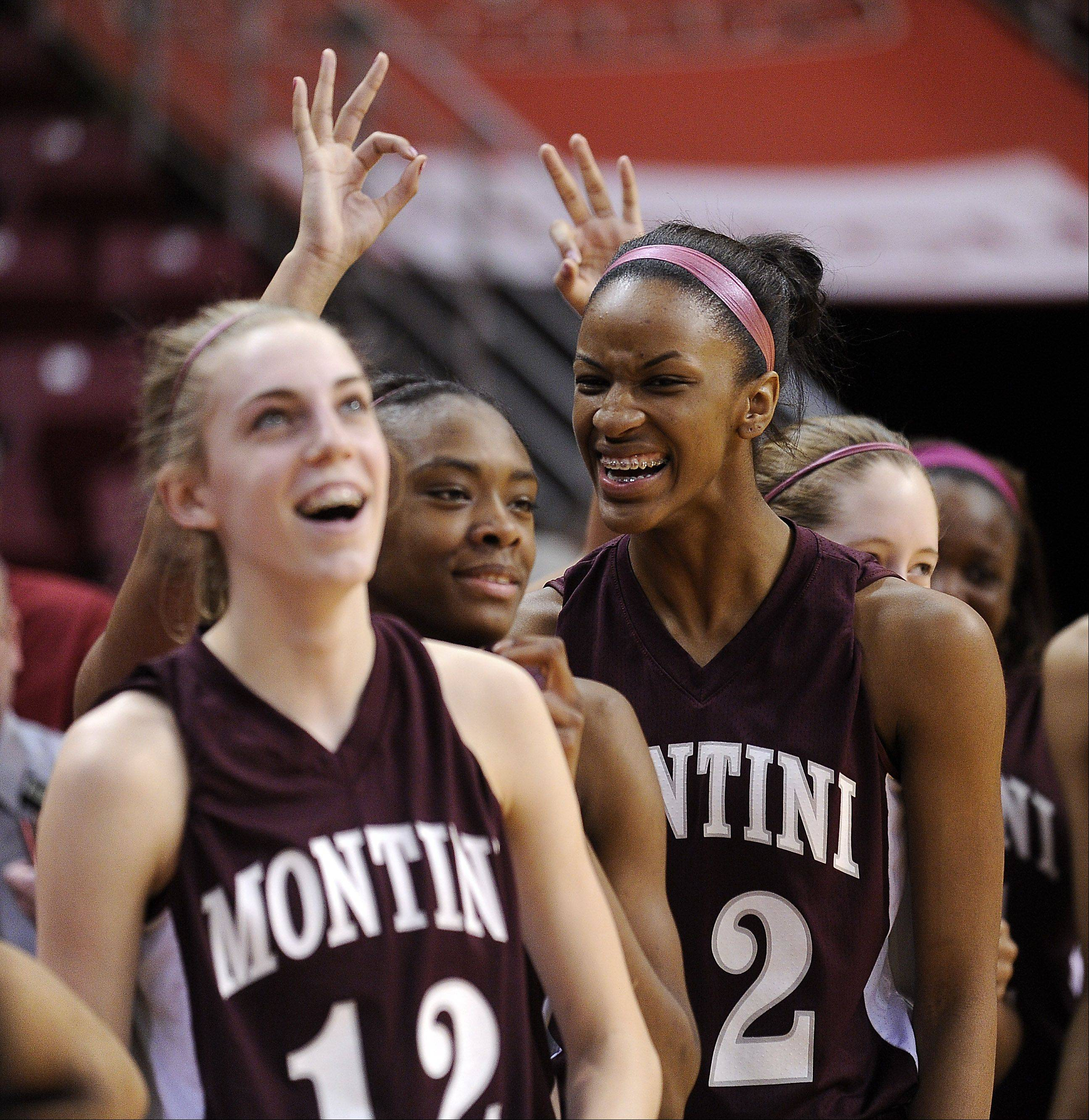 Montini's bench starts to celebrate with smiles and three-peat signs as they beat Vernon Hills in the 2012 IHSA Class 3A Girls Basketball Tournament in Normal, Illinois on Saturday.
