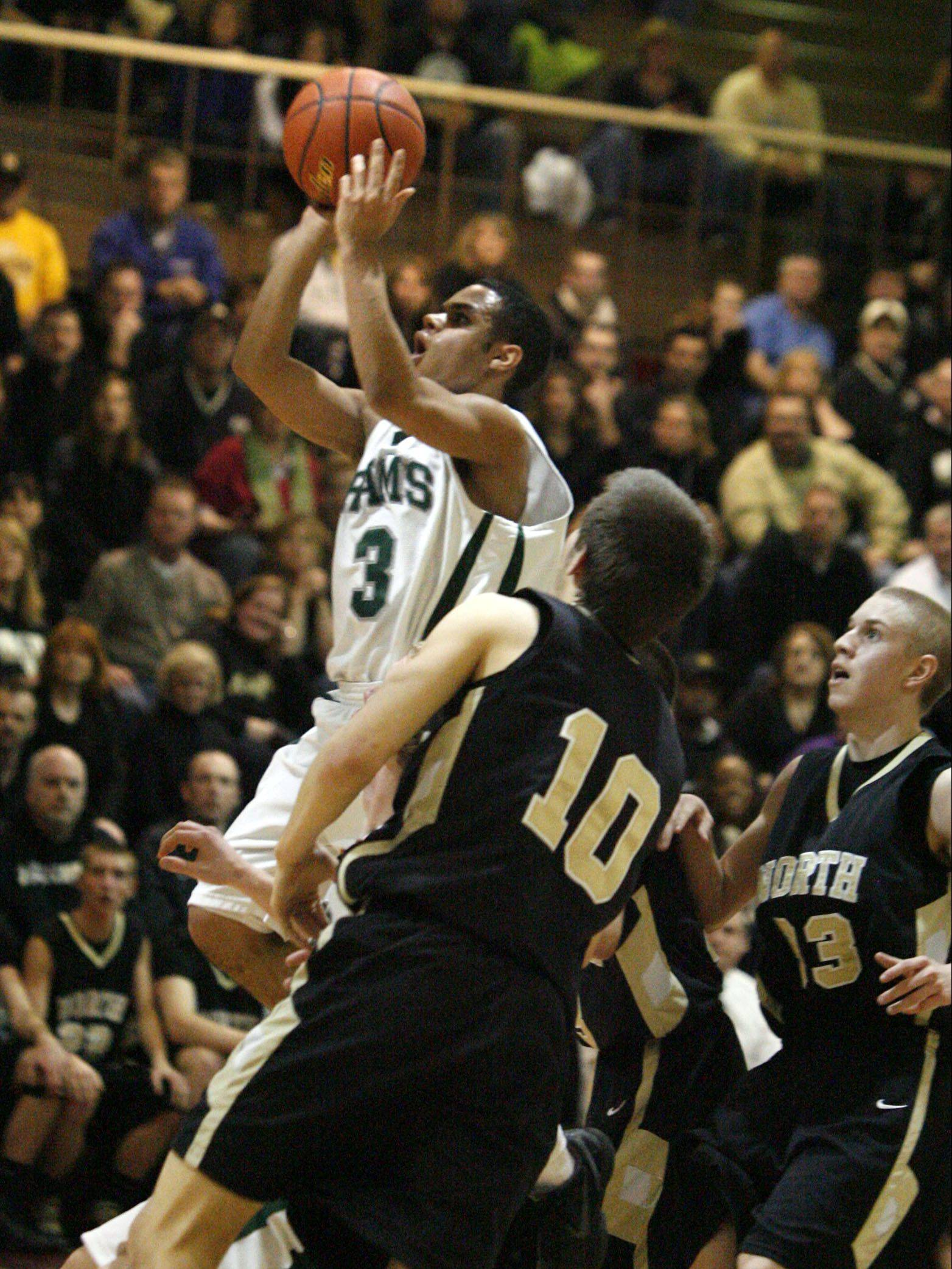 George Leclaire/gleclaire@dailyherald.com Grayslake Central's Jordan Taylor (all-Small) shoots past Grayslake North defender A.J. Fish (all-Junior) in Class 3A regional final play at Antioch on Friday.
