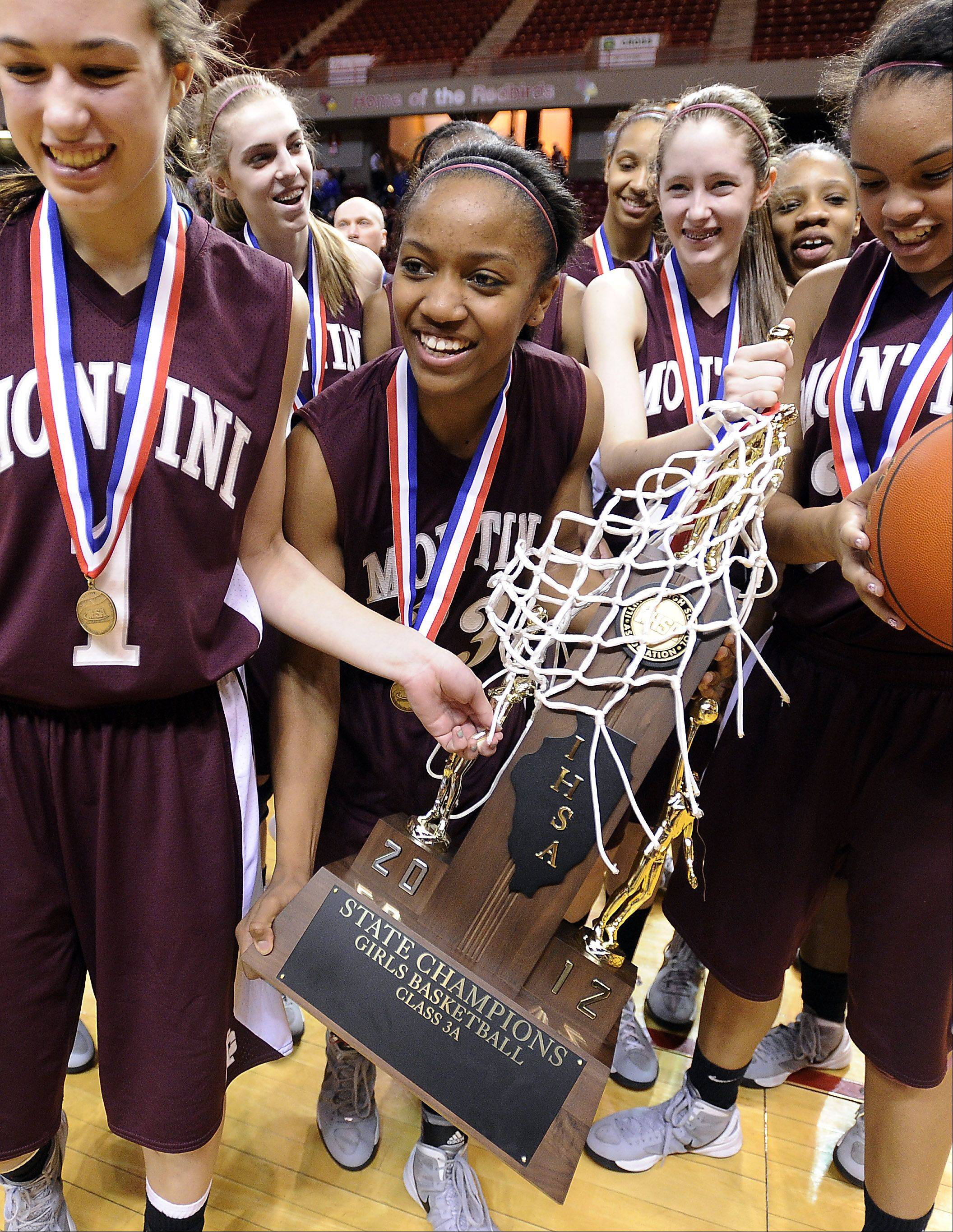 Montini's Sara Ross with the rest of her teammates hold the first place trophy after their victory over Vernon Hills in the 2012 IHSA Class 3A Girls basketball Tournament in Normal, Illinois on Saturday.