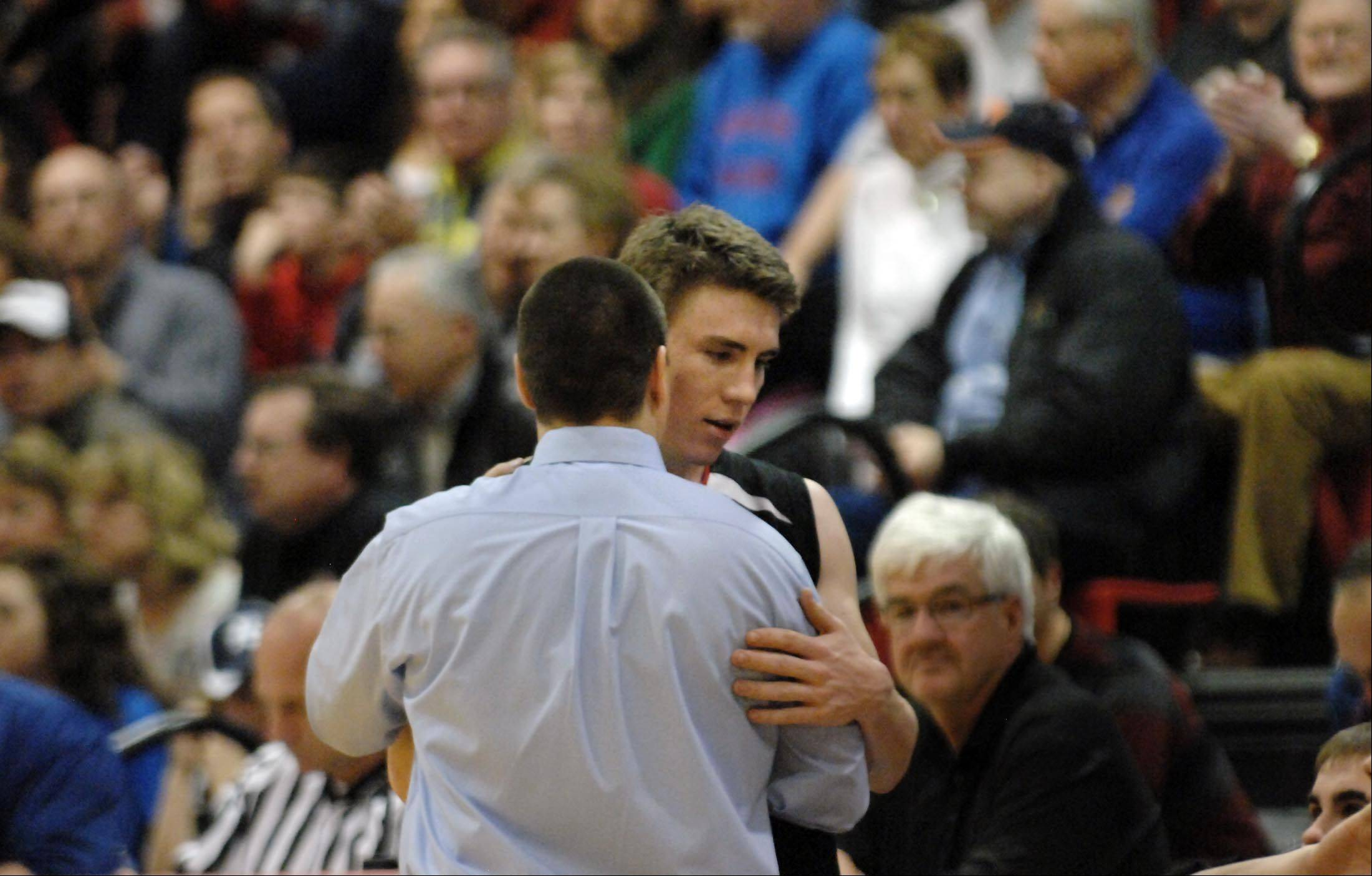 Huntley's Troy Miller gets a word from coach Marty Manning as he leaves the game against Rockford Auburn in the Class 4A Dundee-Crown sectional semifinal game Tuesday in Carpentersville.