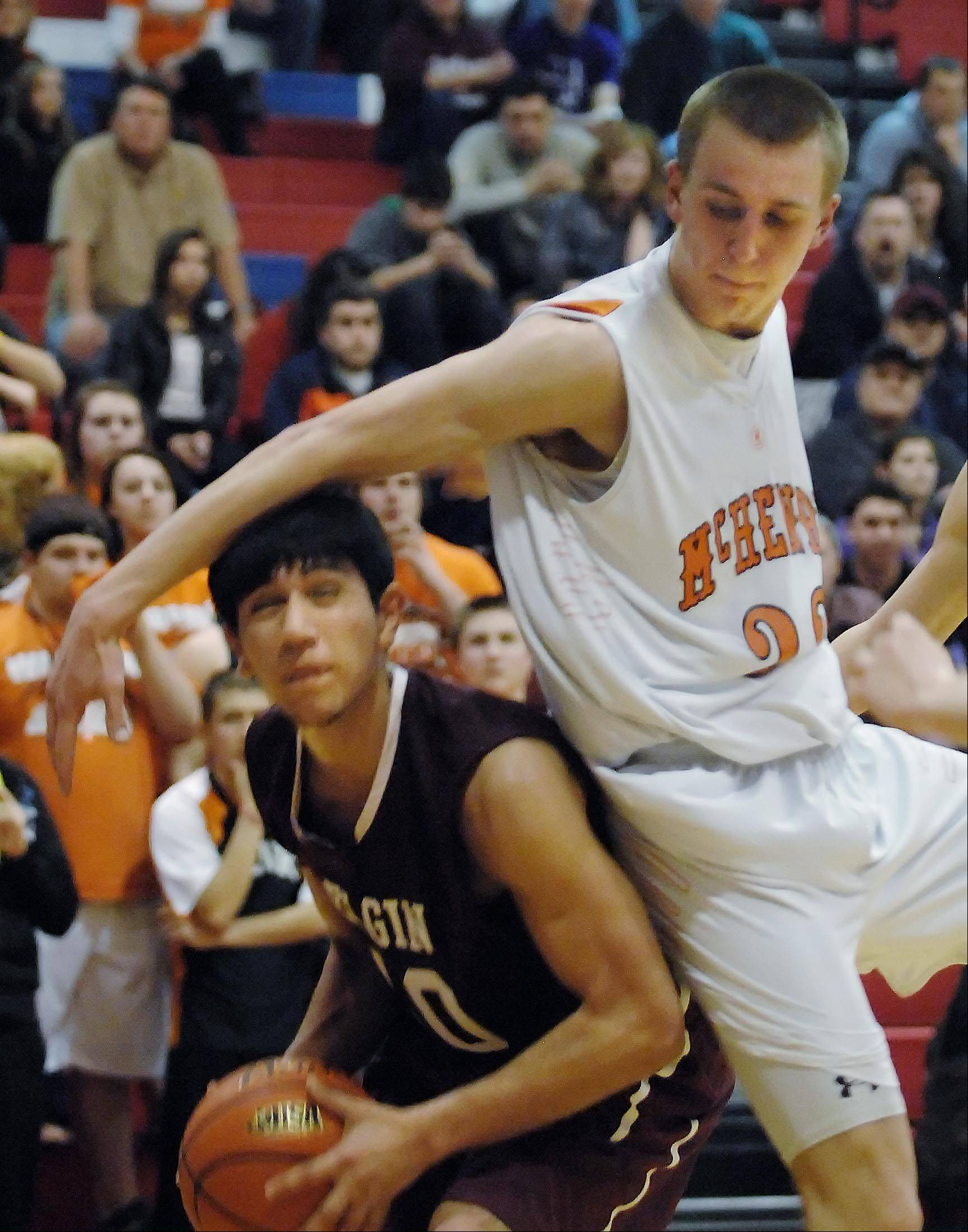Elgin's Gerardo Mojica is fouled by McHenry's Jamie Rammel Wednesday in the Class 4A Dundee-Crown sectional semifinal game in Carpentersville.
