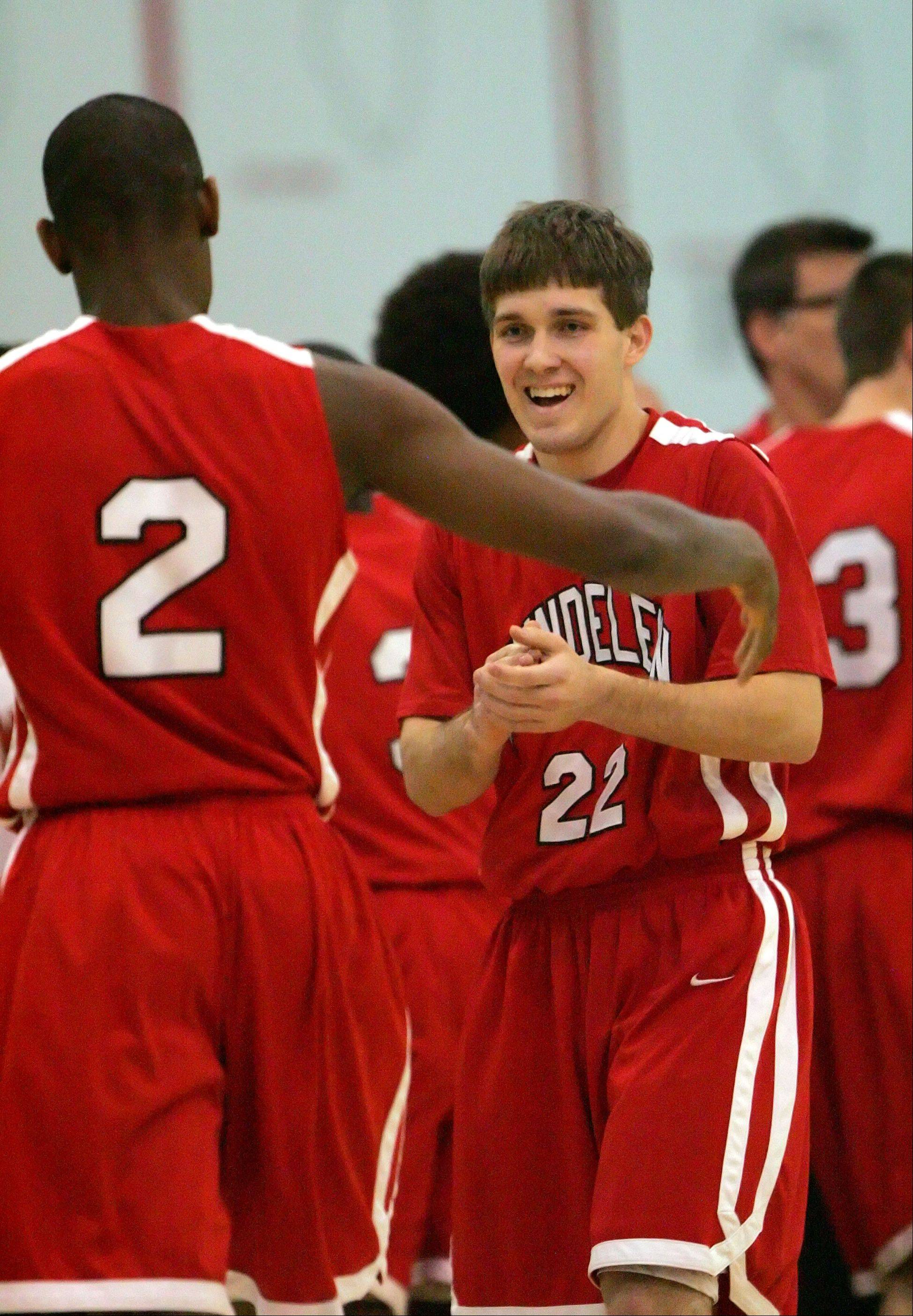 Mundelein's Chino Ebube, left, celebrates with Robert Knar.