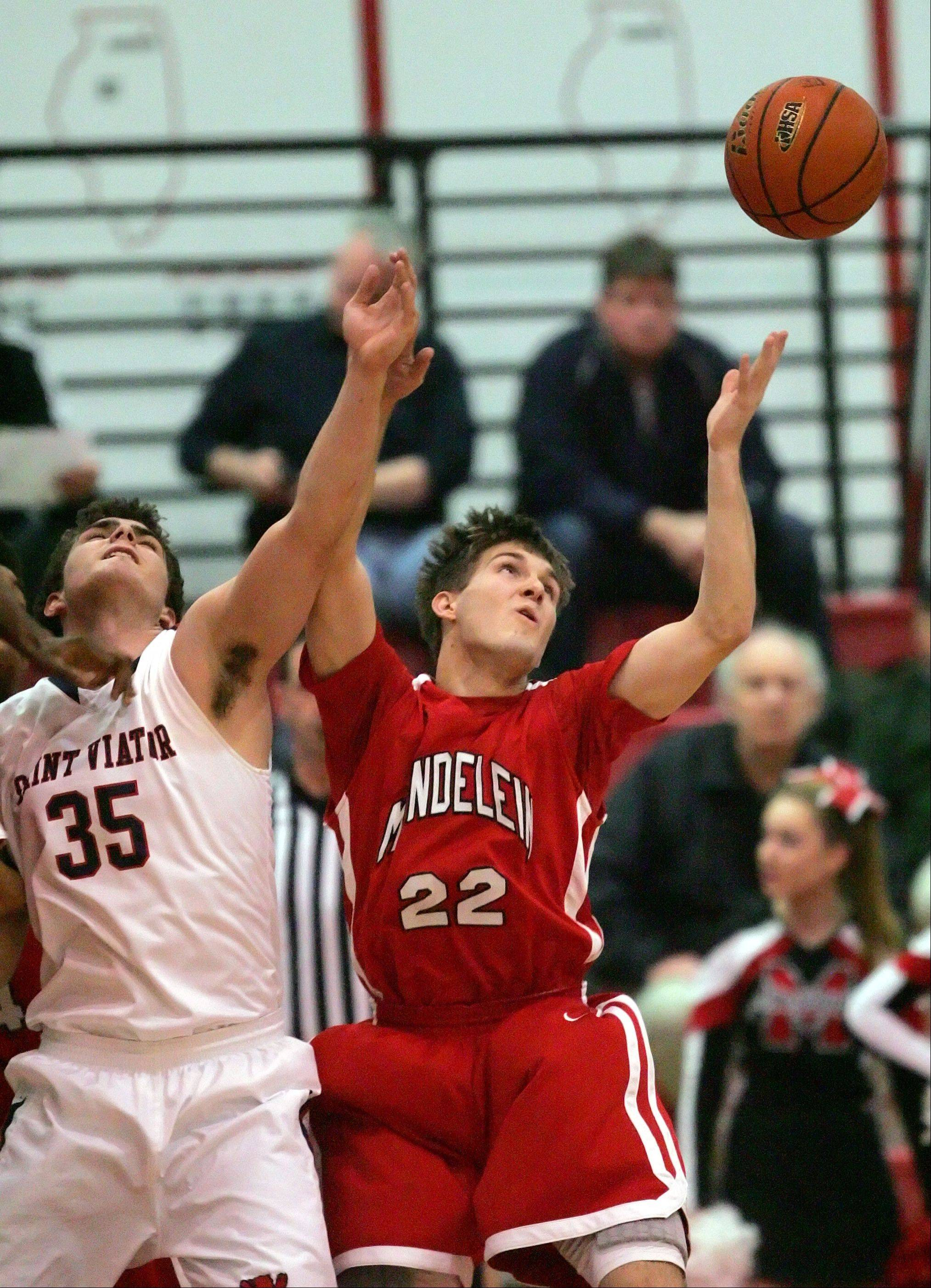 St. Viator Chris Myjak, left, and Mundelein's Robert Knar battle for a rebound.
