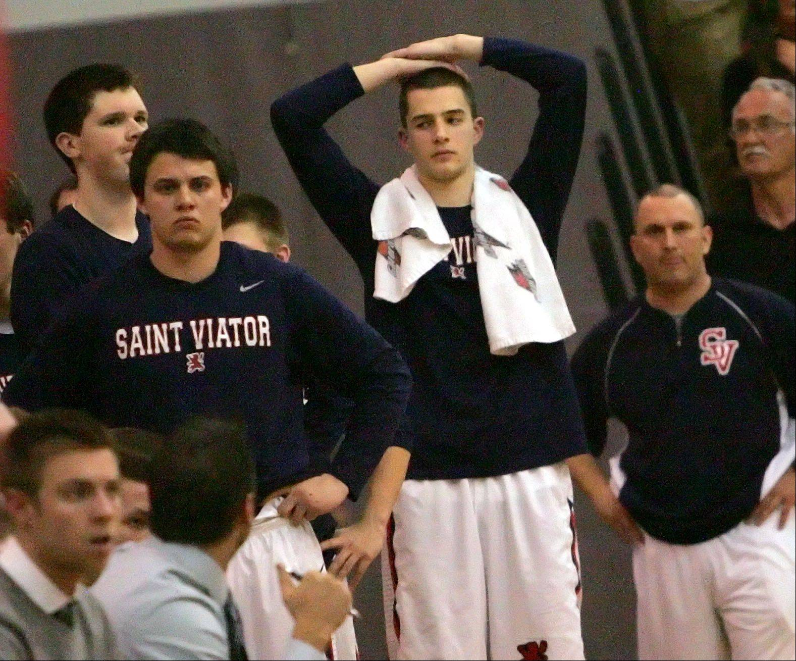 Players on the St. Viator bench react after their loss to Mundelein.