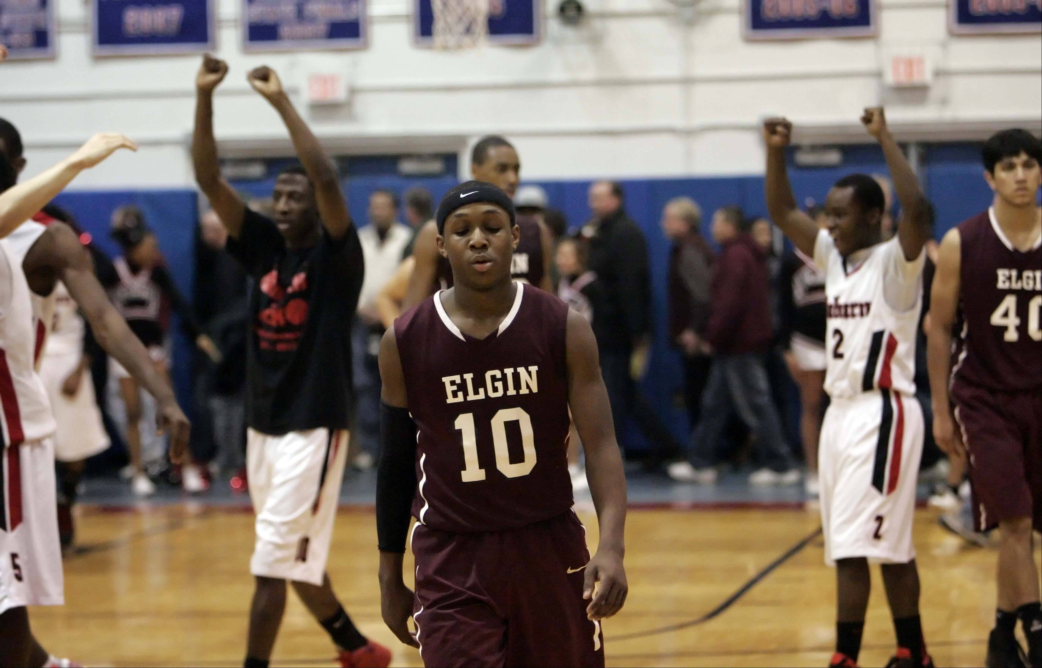 Elgin wing Arie Williams walks off the court after the game.