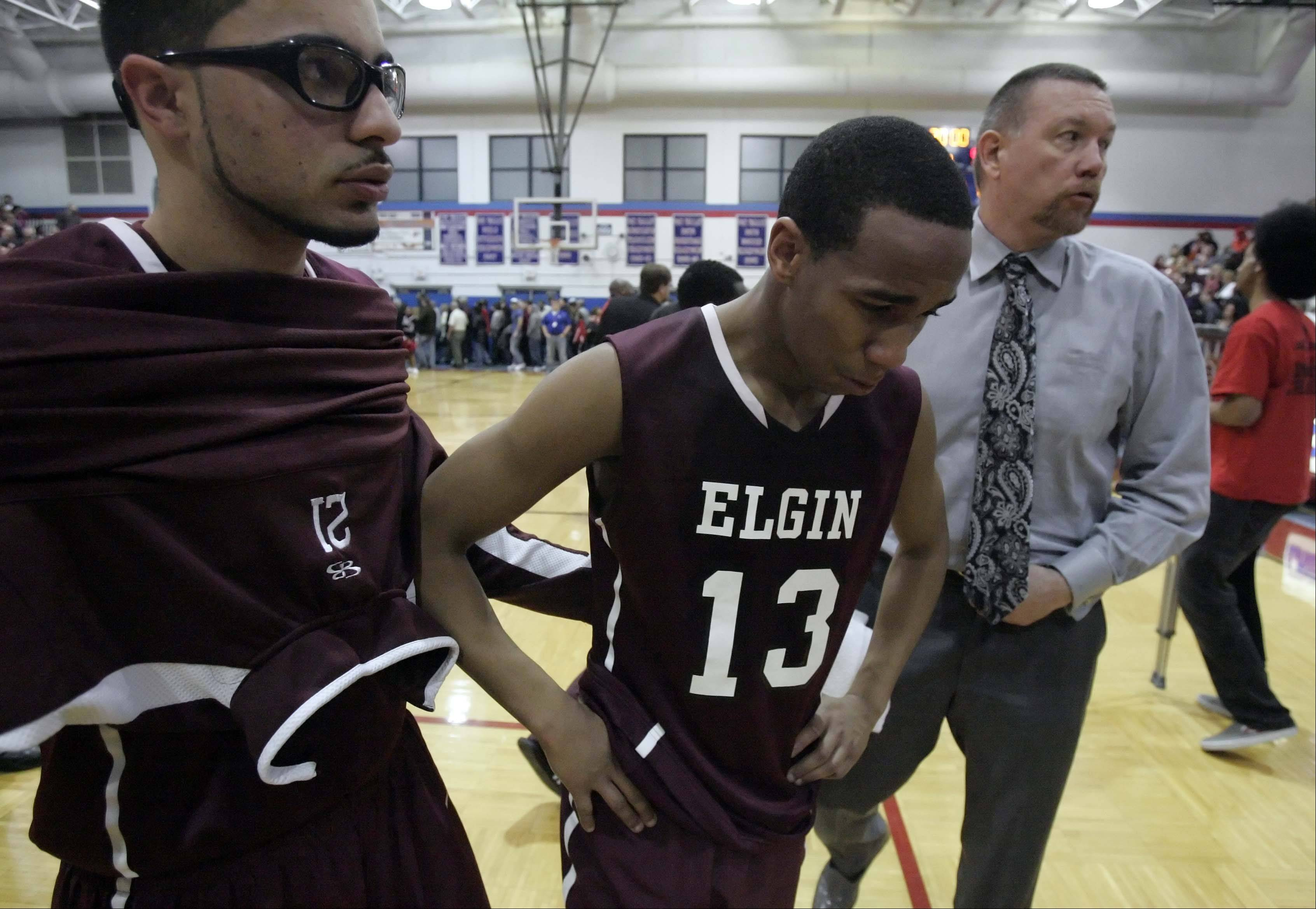 Elgin wing Cortez Scott reacts after a loss to Rockford Auburn .