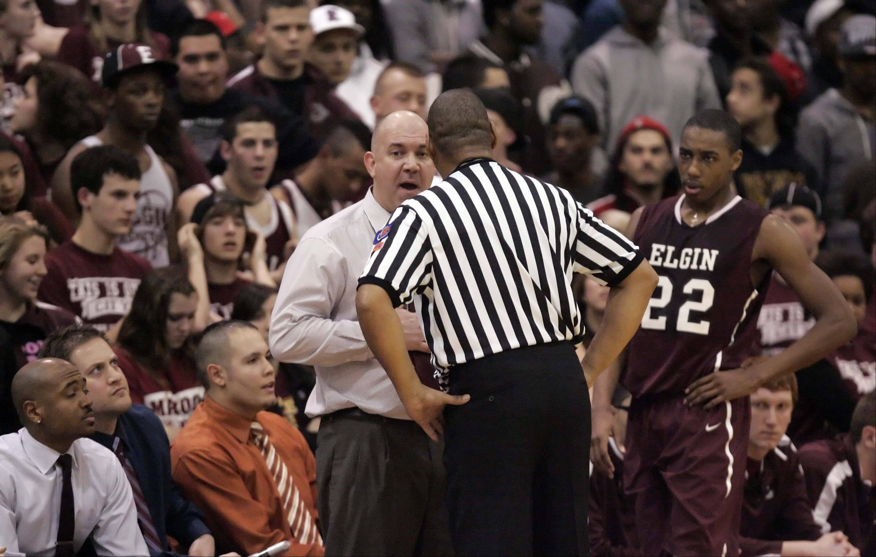 Elgin head coach Michael Sitter talks to the referee after Elgin wing Kory Brown received his third foul.
