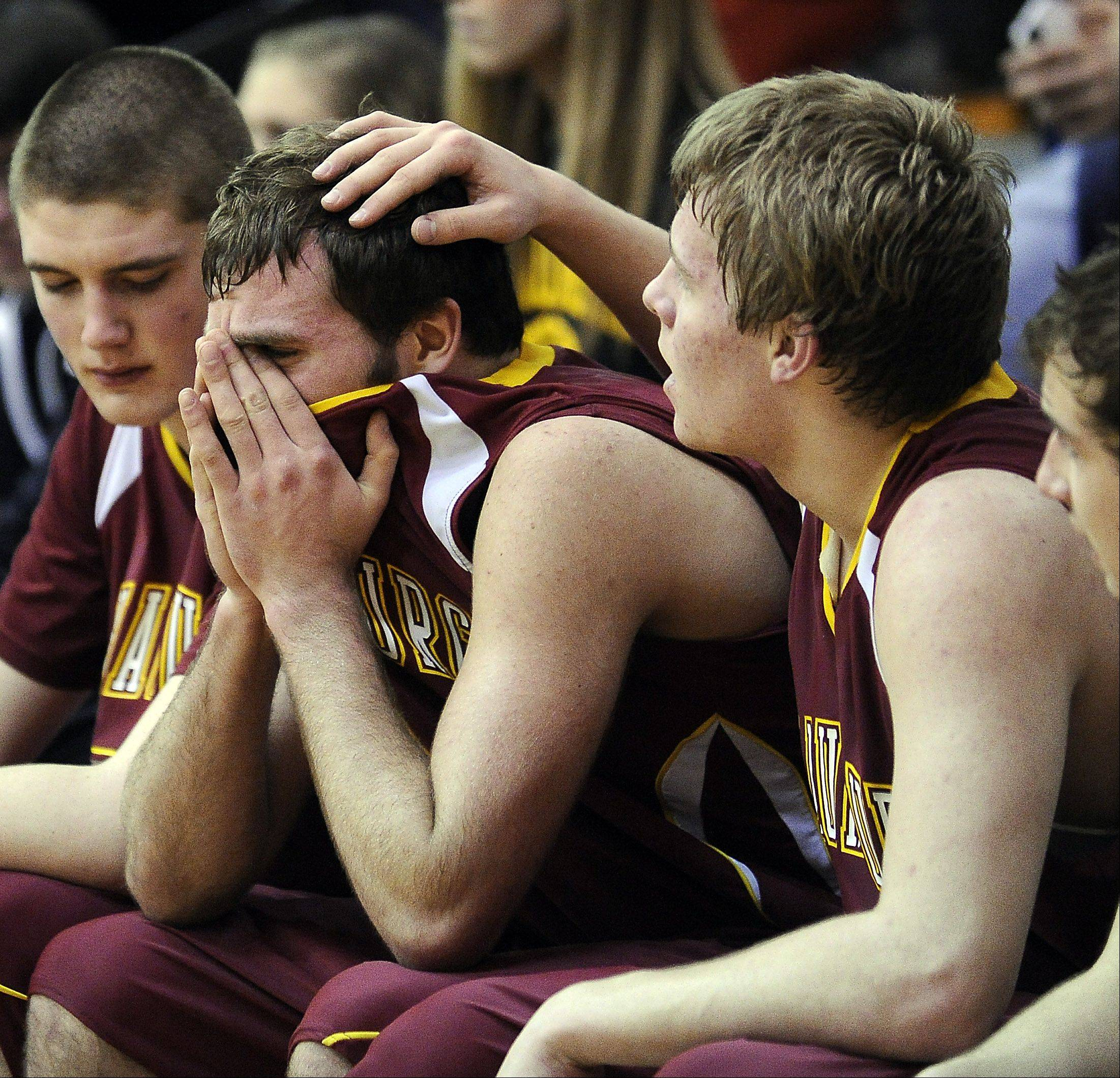 Schaumburg's Kyle Bolger comforts Christian Spandiary as their season comes to a conclusion.
