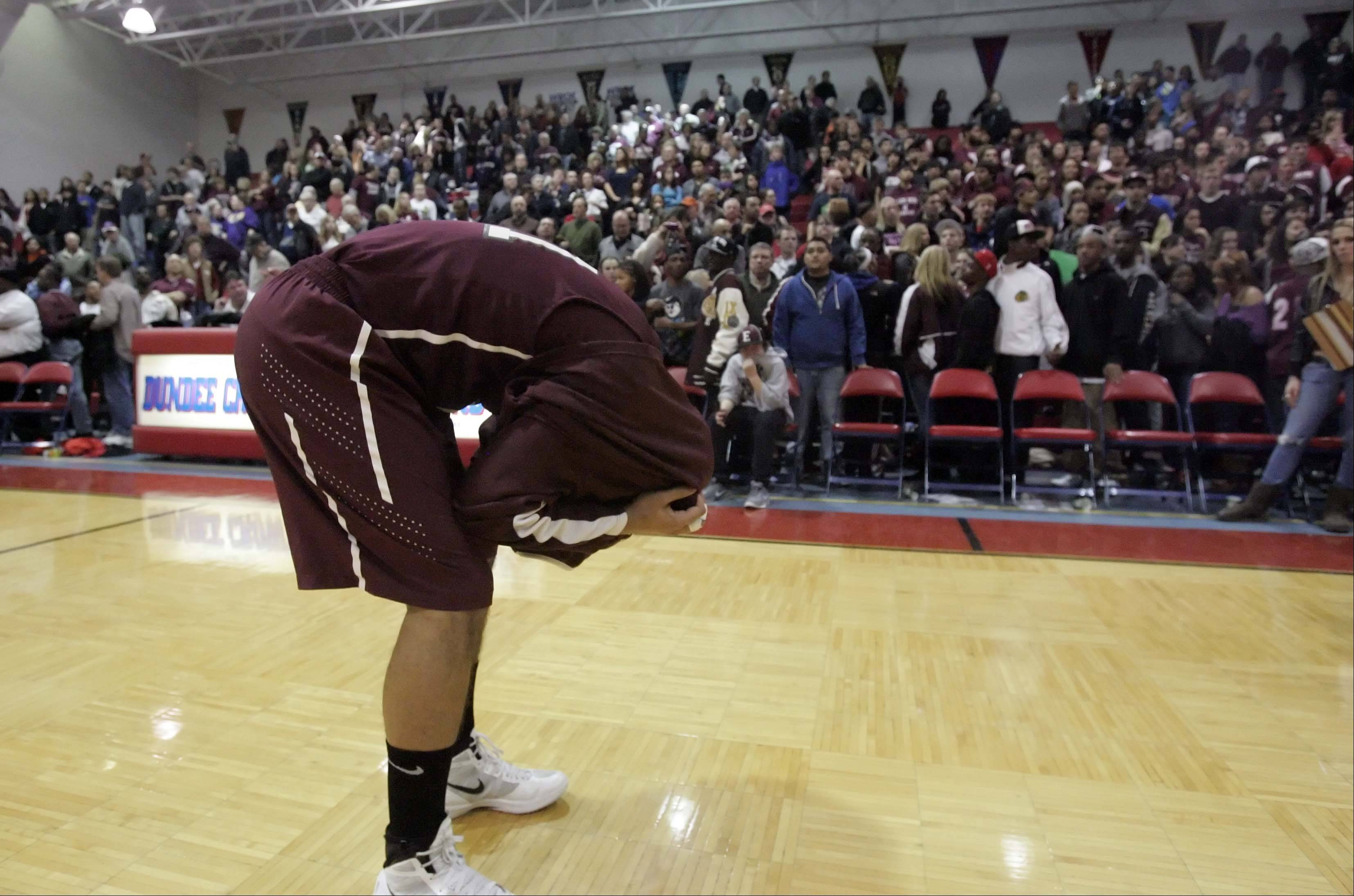 Elgin's Derek Moorman (21) reacts after loss to Rockford Auburn in the IHSA Class 4A sectional final at Dundee-Crown in Carpentersville March 9, 2012.