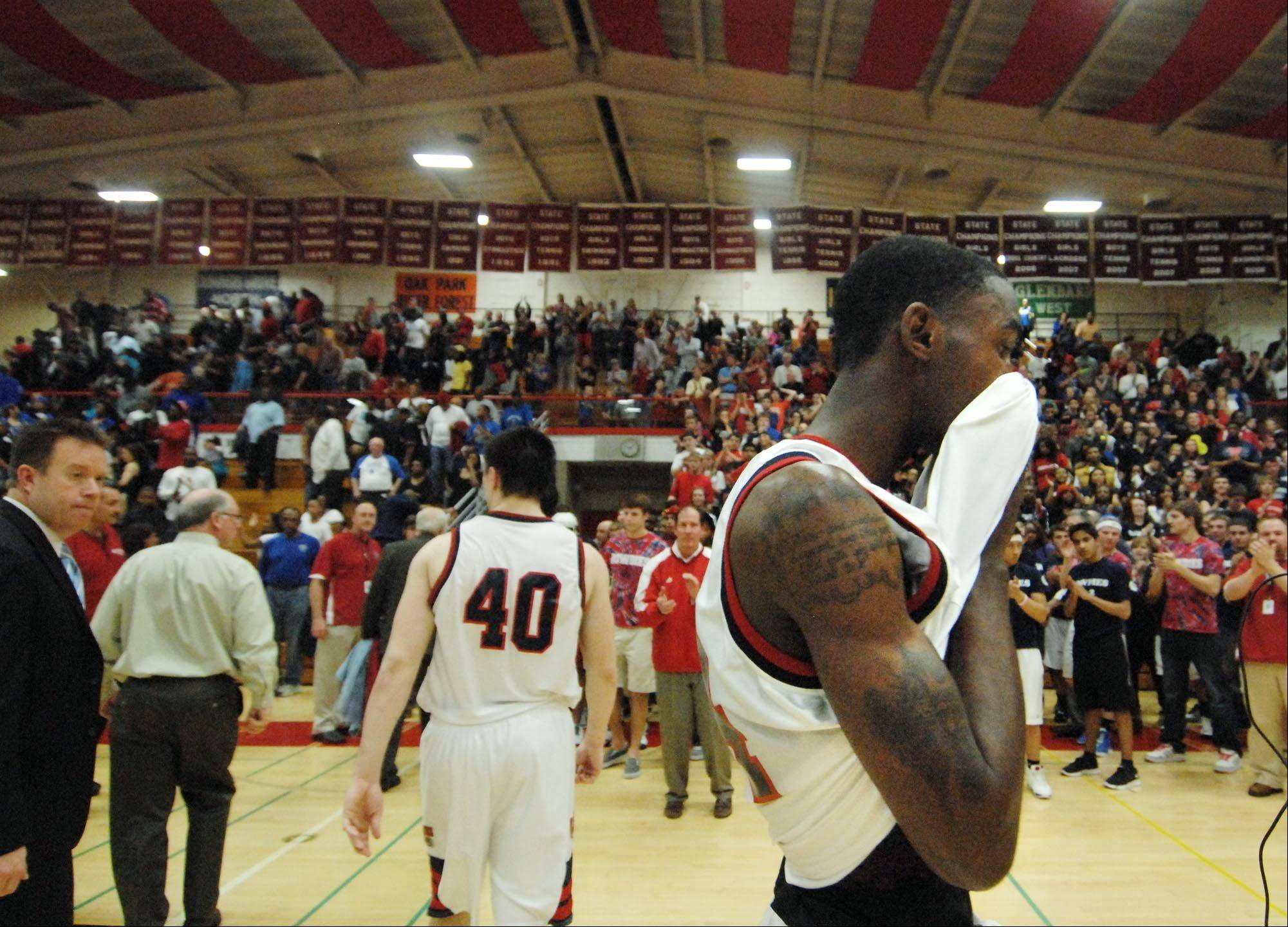 West Aurora's Juwan Starks reacts after losing to Proviso East in the Hinsdale Central supersectional game.