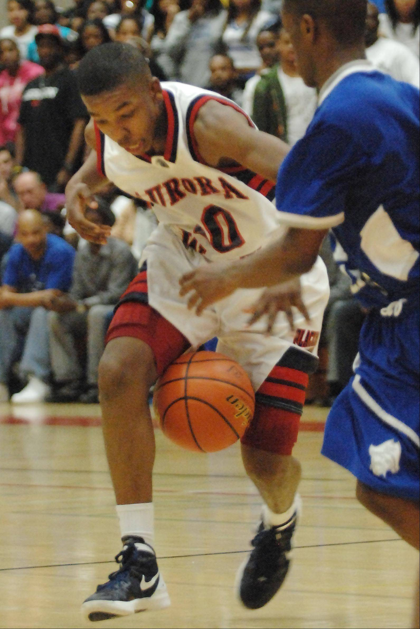 West Aurora's Jontrel Walker loses control of the ball late in the game .