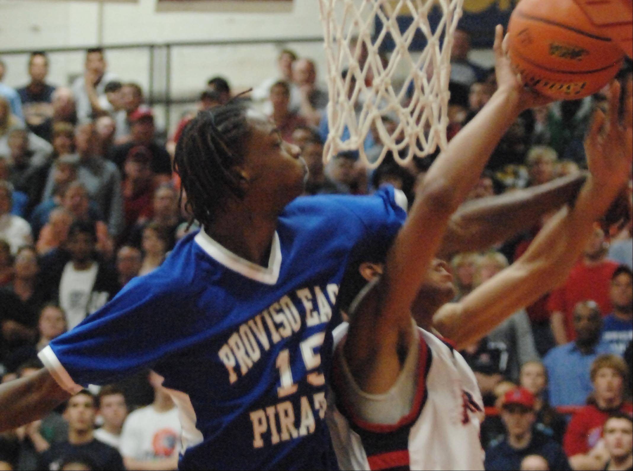 Proviso East's Isaiah Grace fouls West Aurora's Joshua McAuley in Tuesday's Hinsdale Central supersectional game.