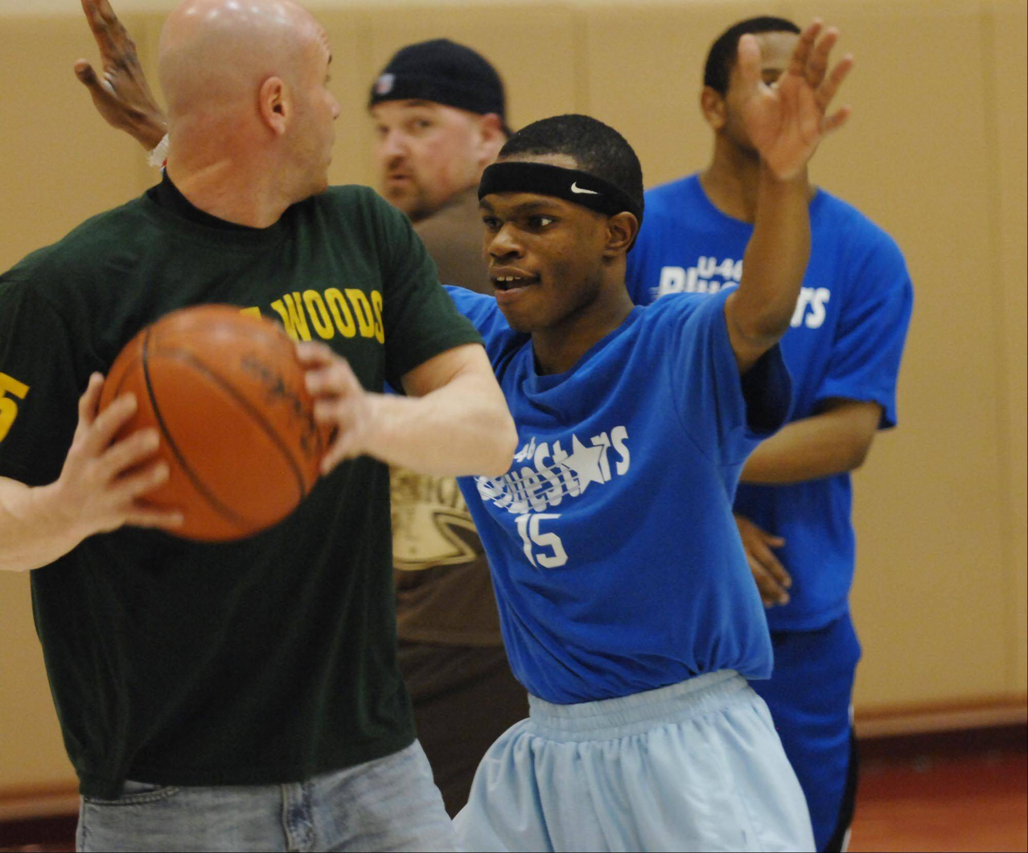 Eugene James guards Coach Mike PaPrairie during Elgin U46 Special Olympics BlueStars High School A team practice.