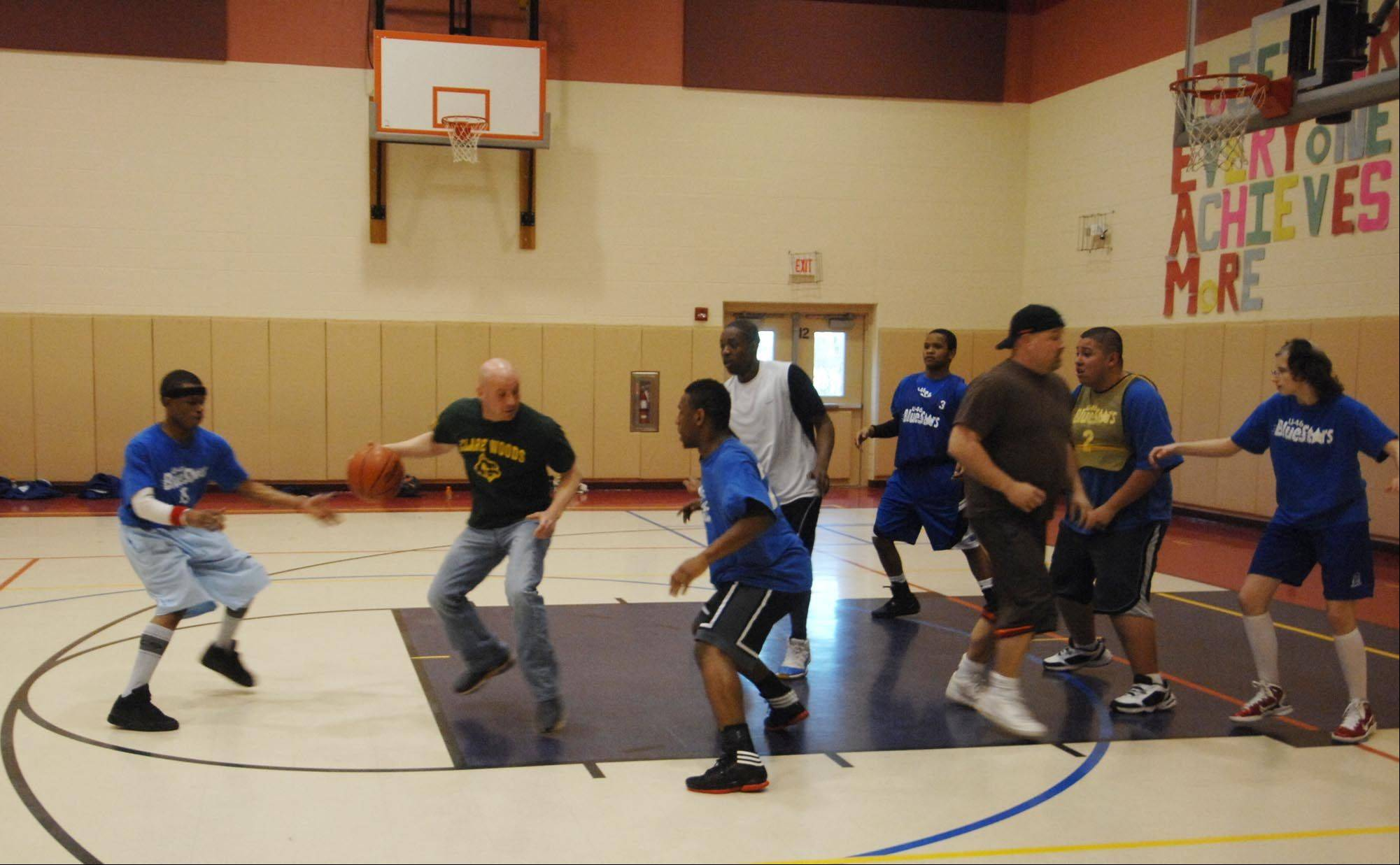 Coach Mike PaPrairie leads the U46 BlueStars High School A team Special Olympics practice.