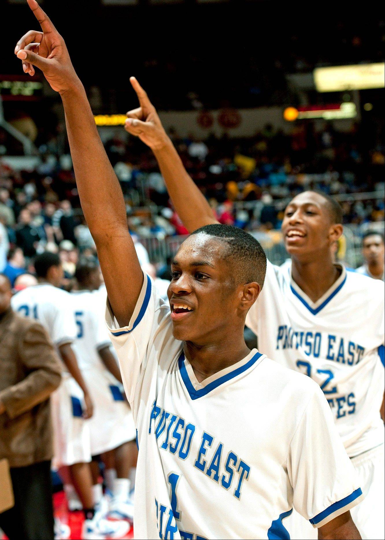 Proviso East guard Paris Lee celebrates after the Pirates topped Rockford Auburn in Friday's Class 4A state semifinals.
